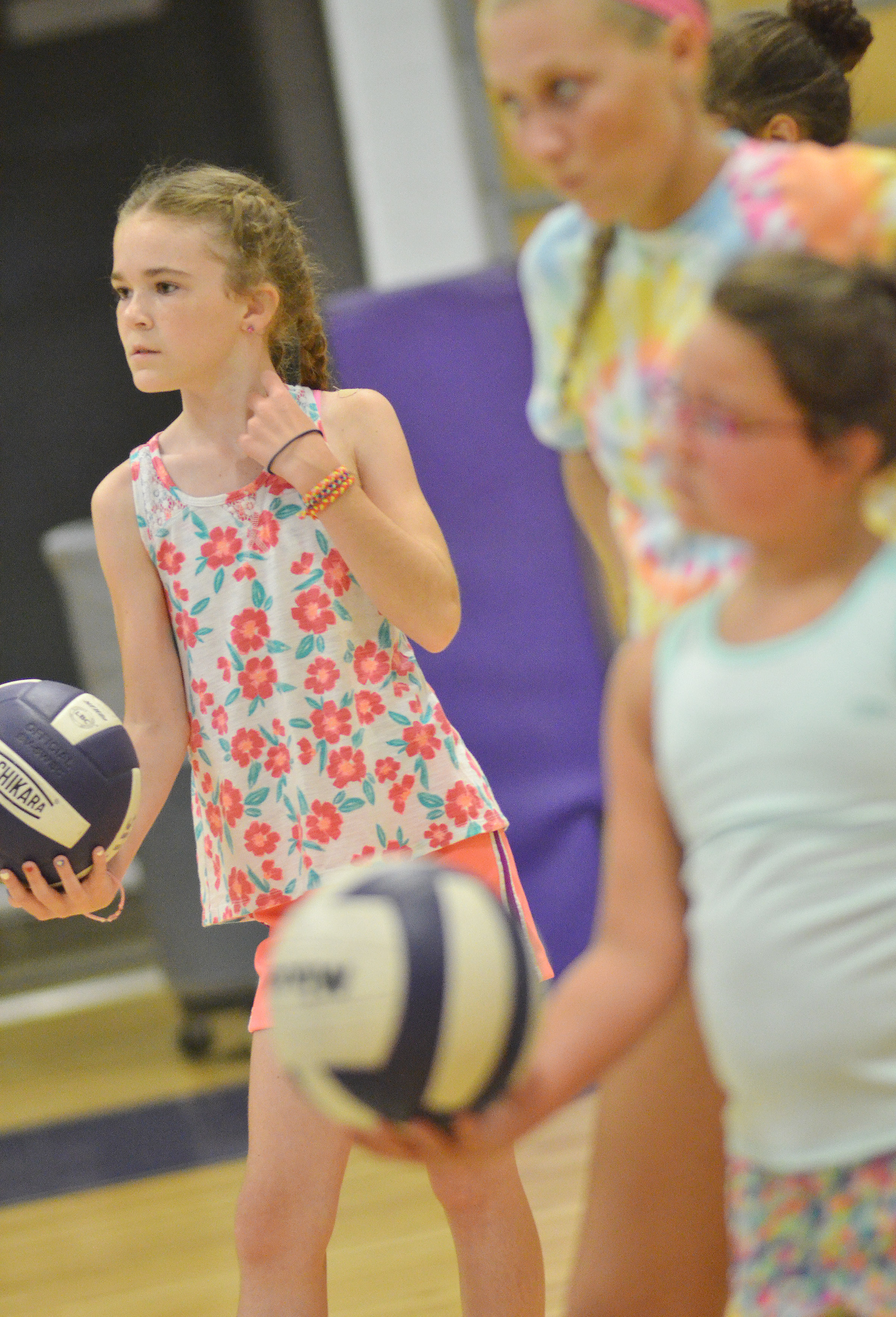 Alissa Hughes, a fourth-grader at Hodgenville Elementary School, gets ready to serve.
