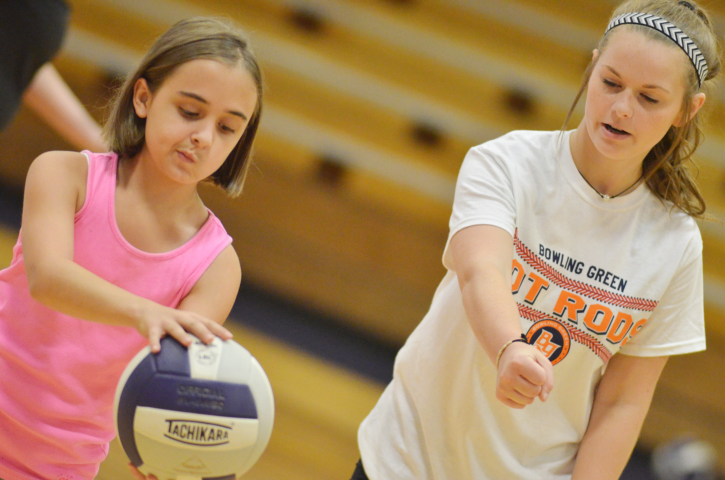 CHS freshman Taylor Knight helps CES fifth-grader Anna Floyd serve.