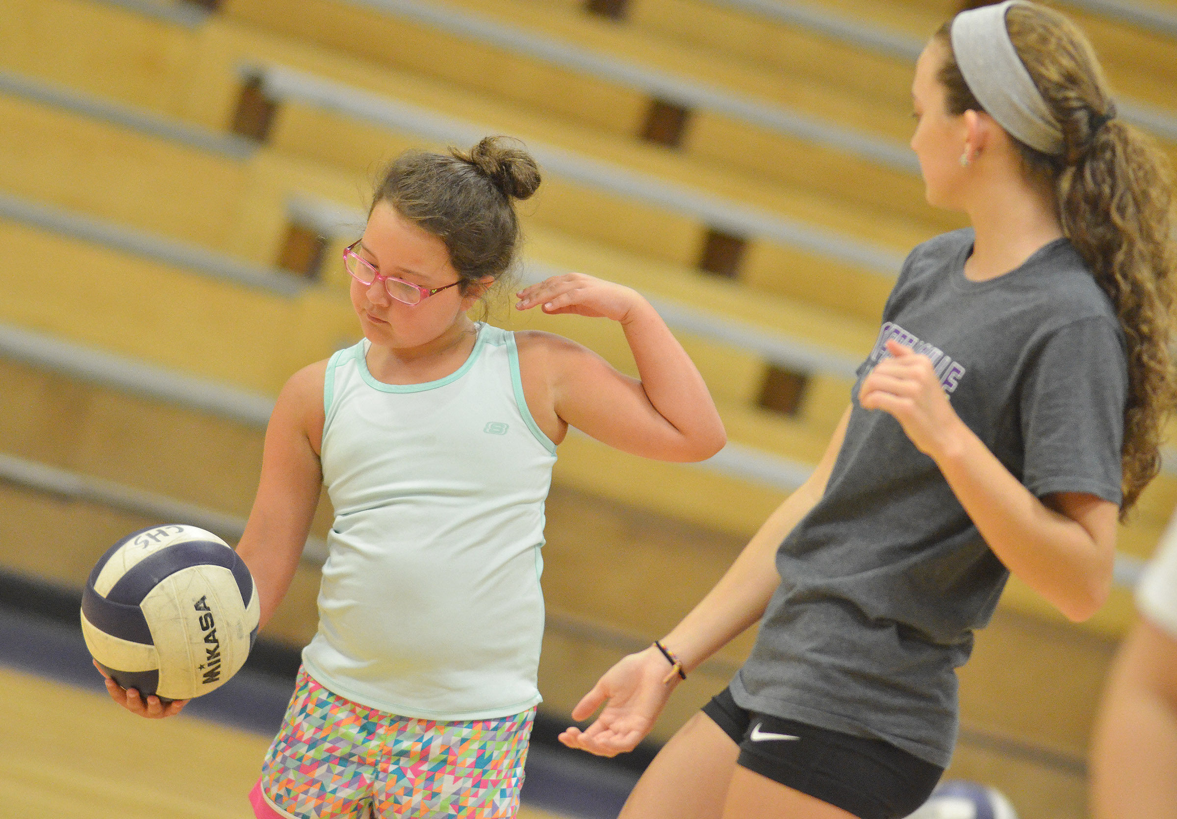 CHS junior Salena Ritchie helps Hadley Brasher, who attends school in Bowling Green, serve.