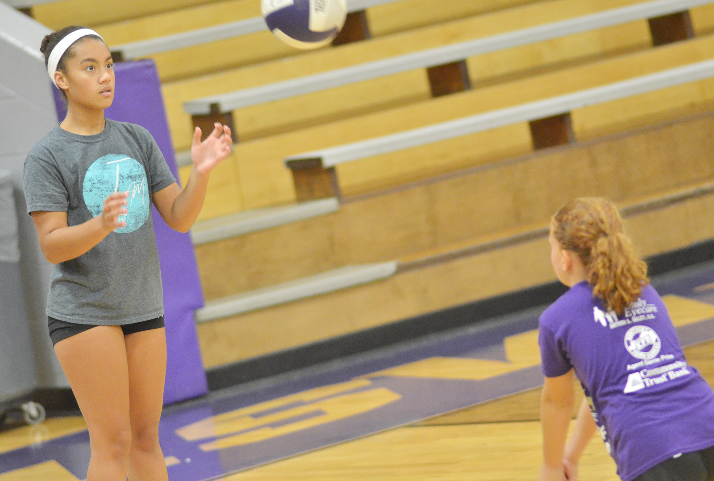 CHS freshman Laci Hodgens practices serving with CES third-grader Analeigh Foster.