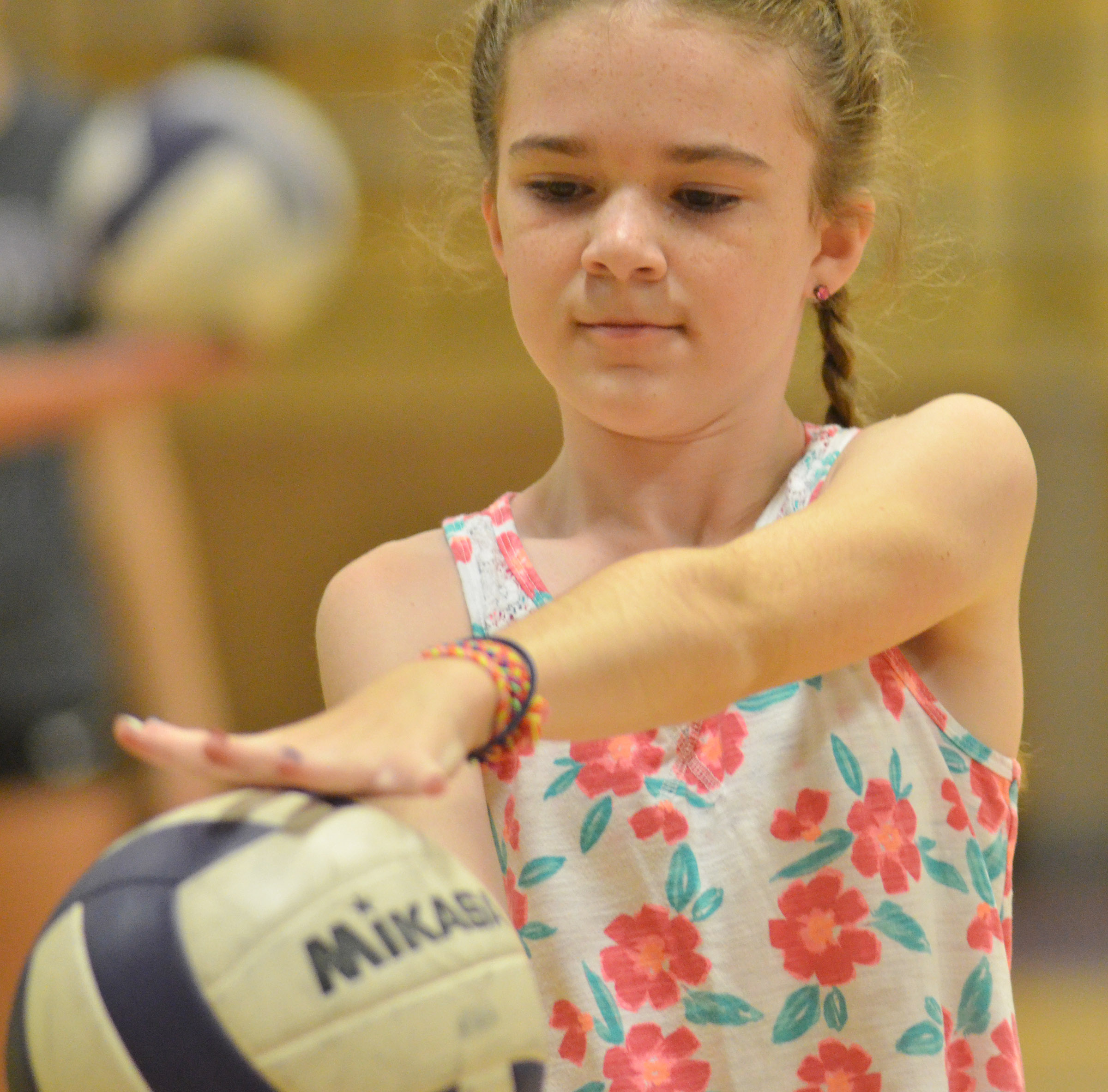 Alissa Hughes, a fourth-grader at Hodgenville Elementary School, learns to serve.