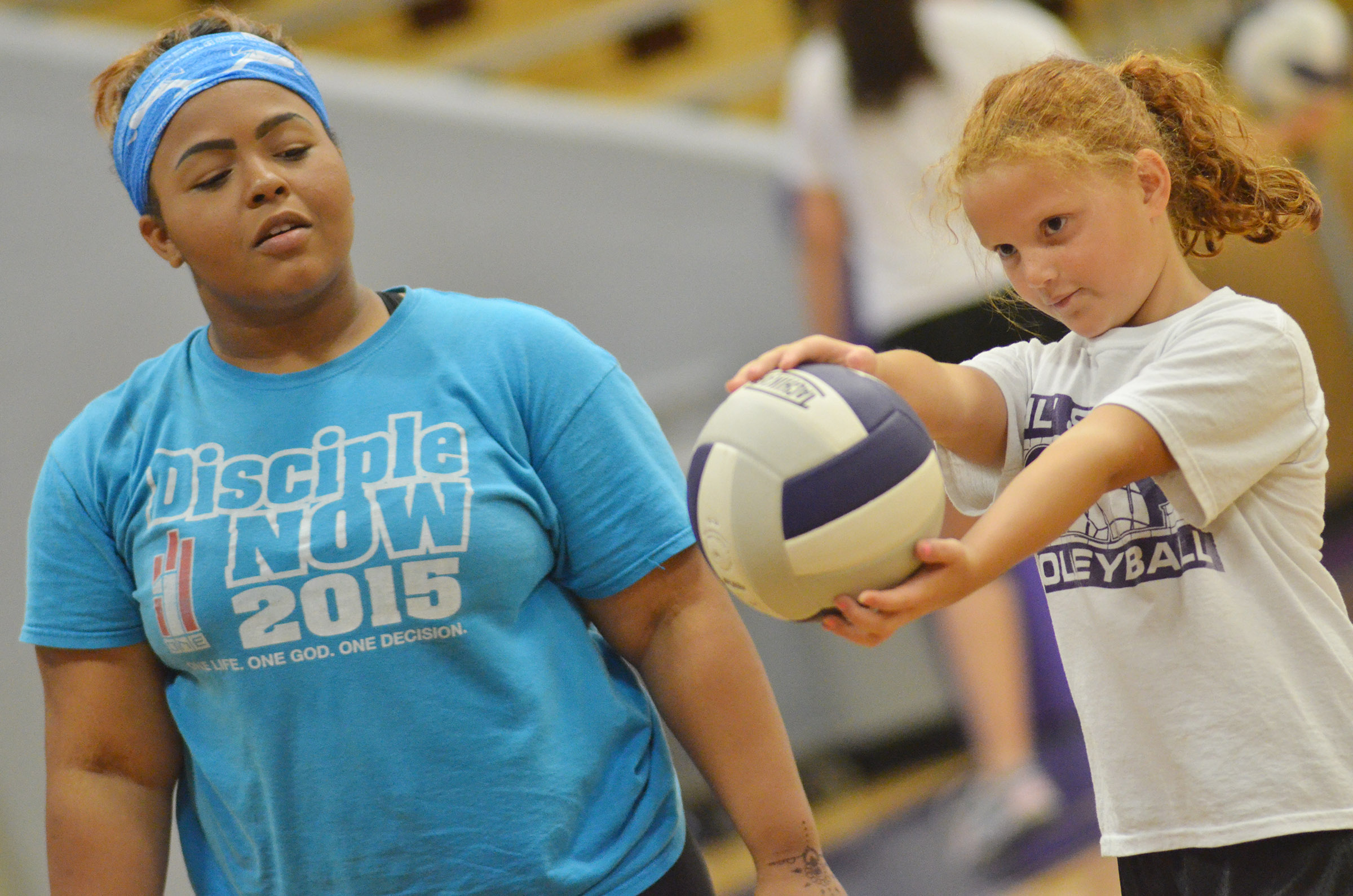 CHS junior Natalie Caldwell helps CES third-grader Analeigh Foster learn to serve.