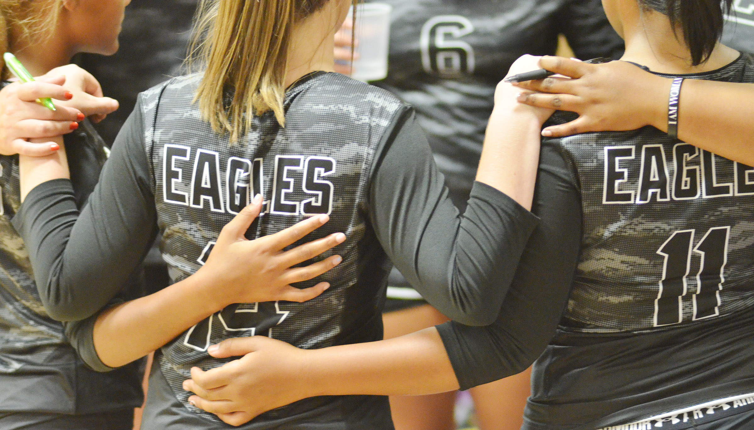 CHS volleyball players huddle during a timeout.