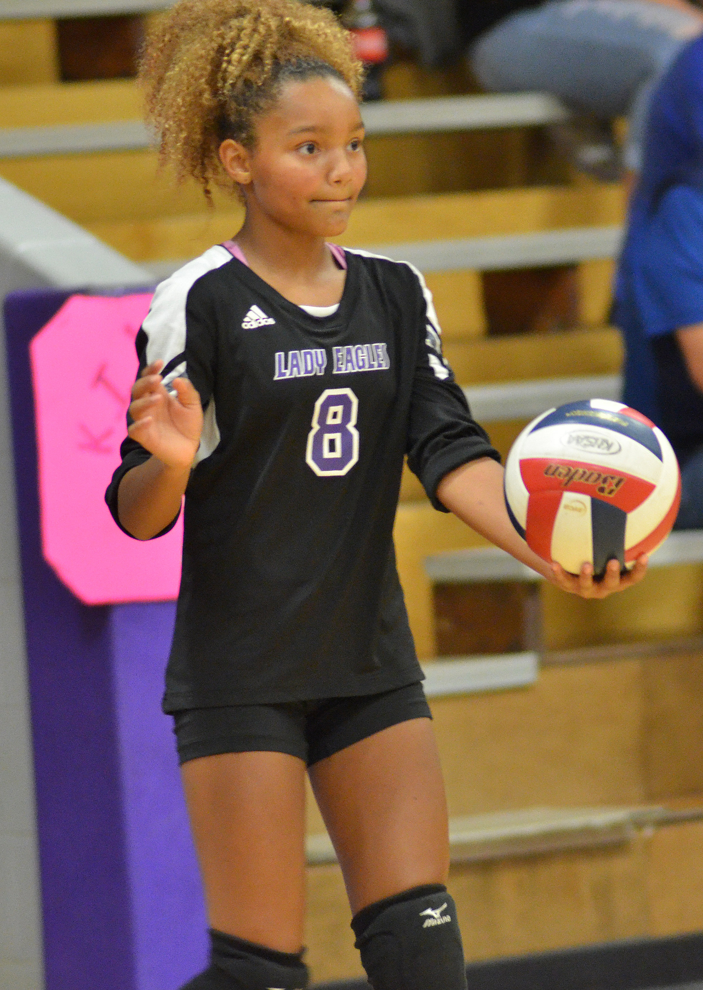 Campbellsville Middle School eighth-grader Alexis Thomas serves.