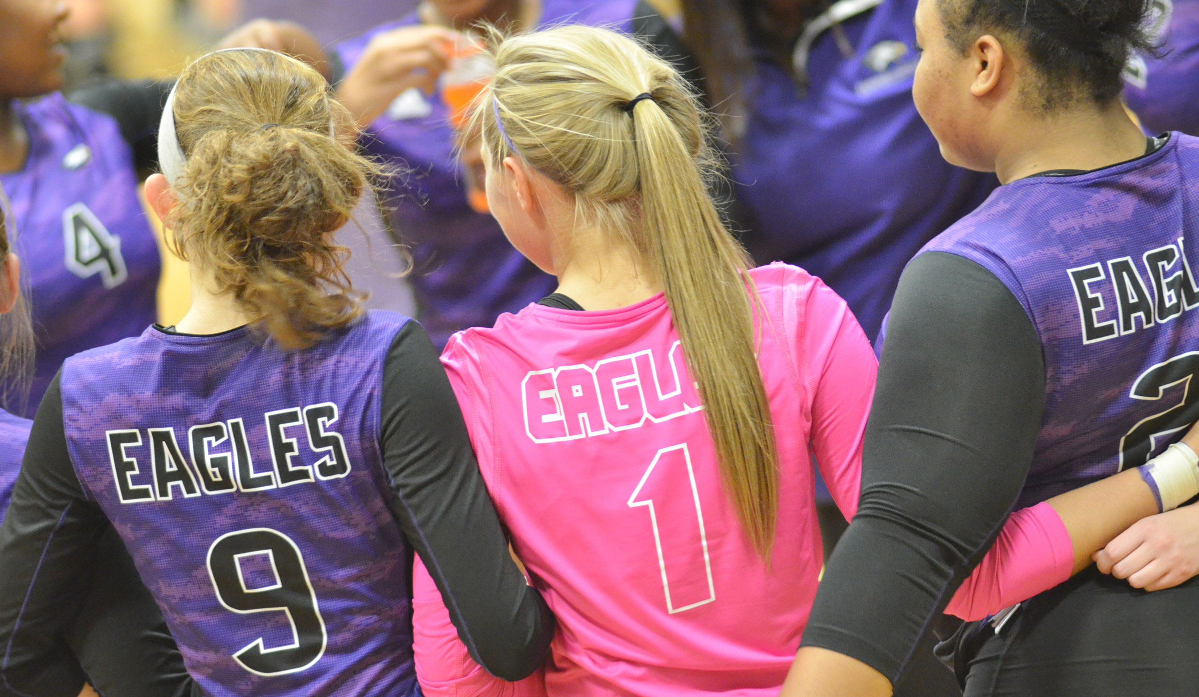 From left, CHS juniors Salena Ritchie, Tatem Wiseman and Natalie Caldwell huddle with their teammates.