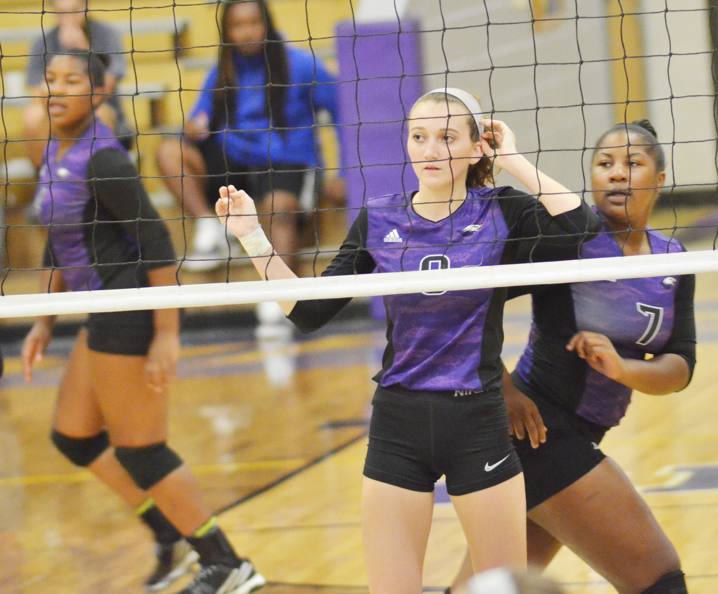 CHS junior Salena Ritchie, at left, and senior Kiyah Barnett watch the ball.