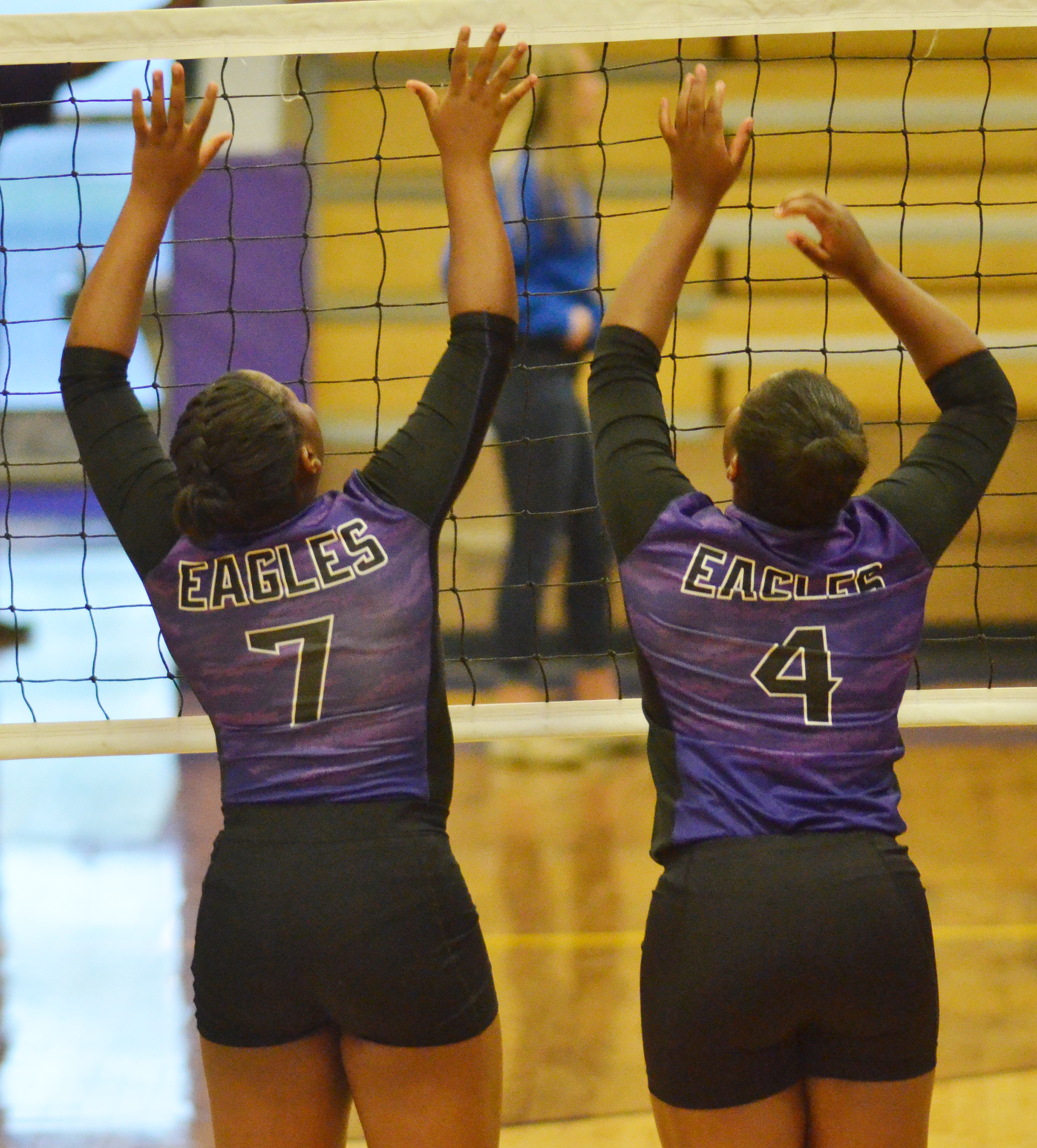 CHS seniors Kiyah Barnett, at left, and Nena Barnett jump during warmup.