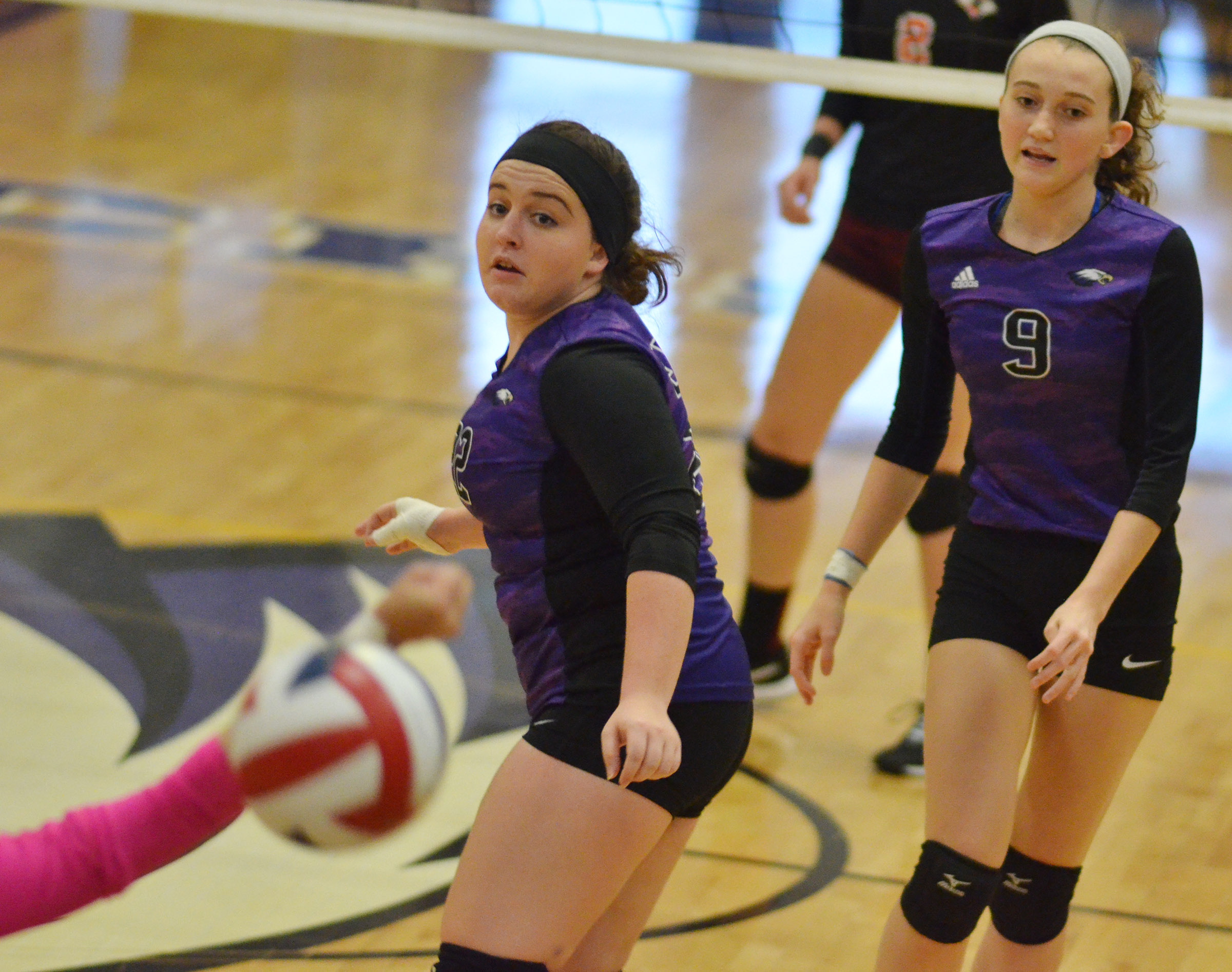 CHS senior Caitlin Bright, at left, and junior Salena Ritchie watch the ball.