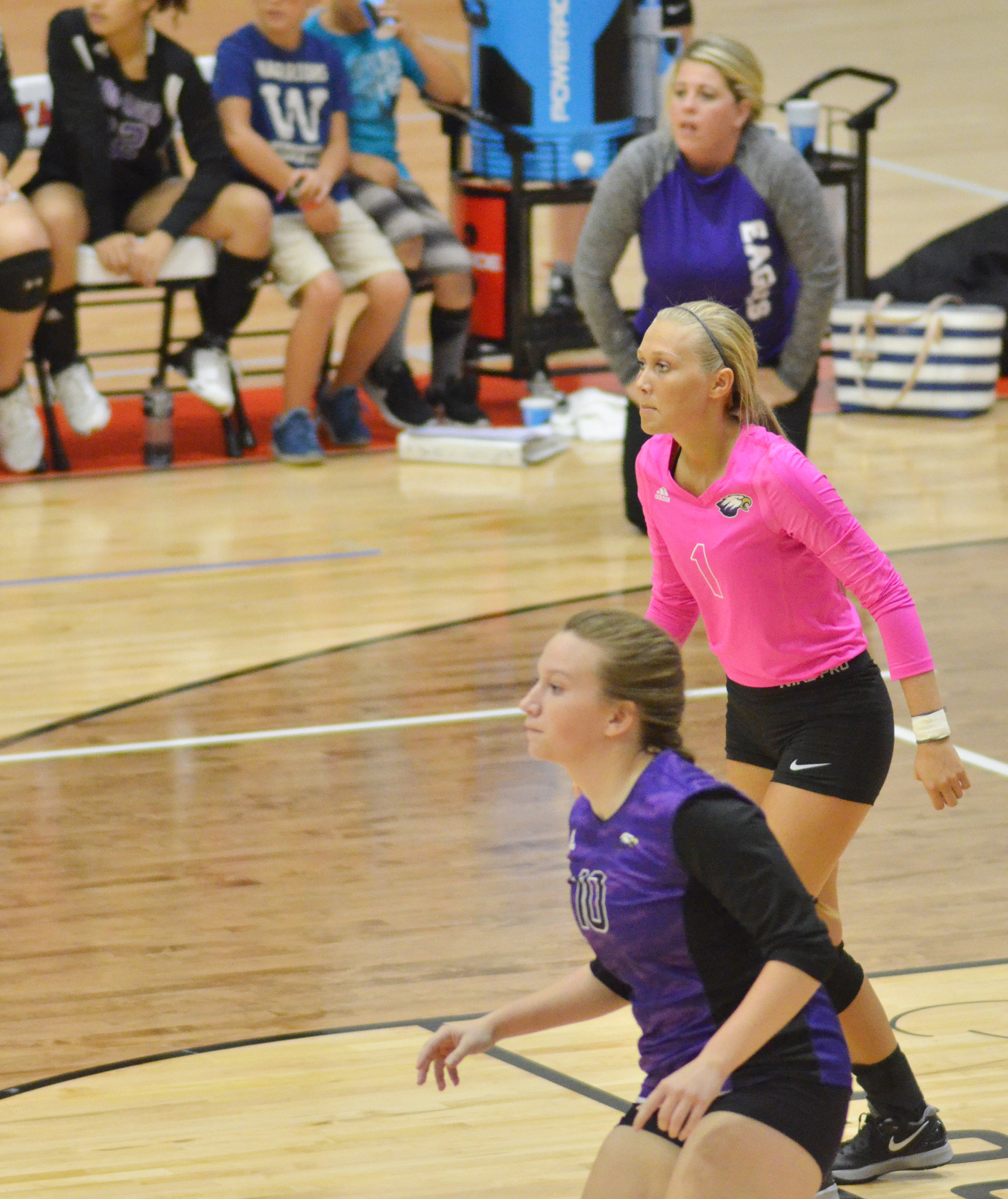 CHS senior Madison Dial, in front, and junior Tatem Wiseman, the libero, get ready for the serve.