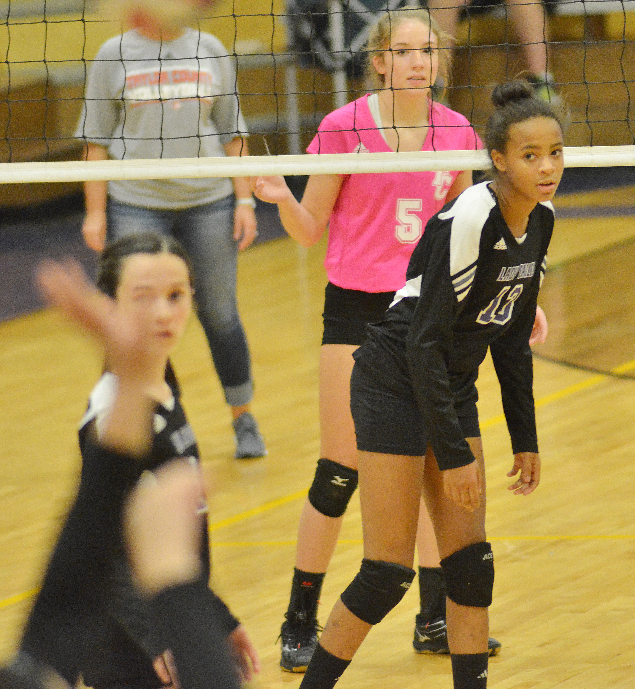 CHS freshman AunDaya Coleman watches as her teammate serves.