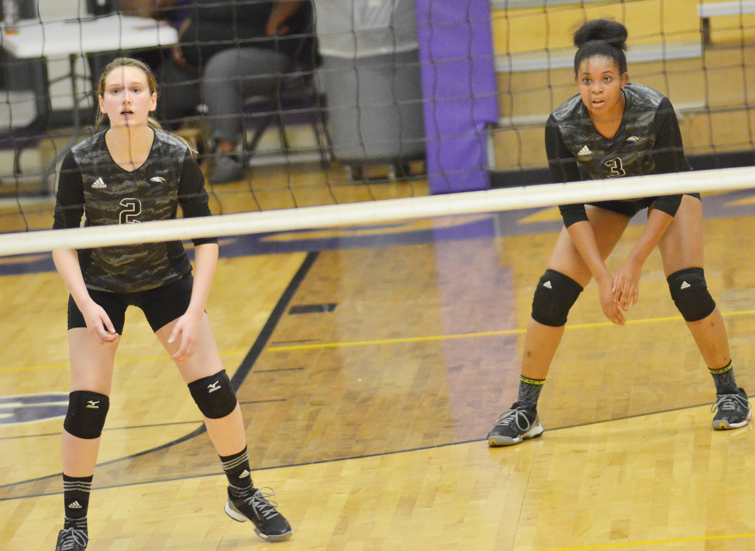 CHS freshman Zoie Sidebottom, at left, and senior Vonnea Smith watch the ball.