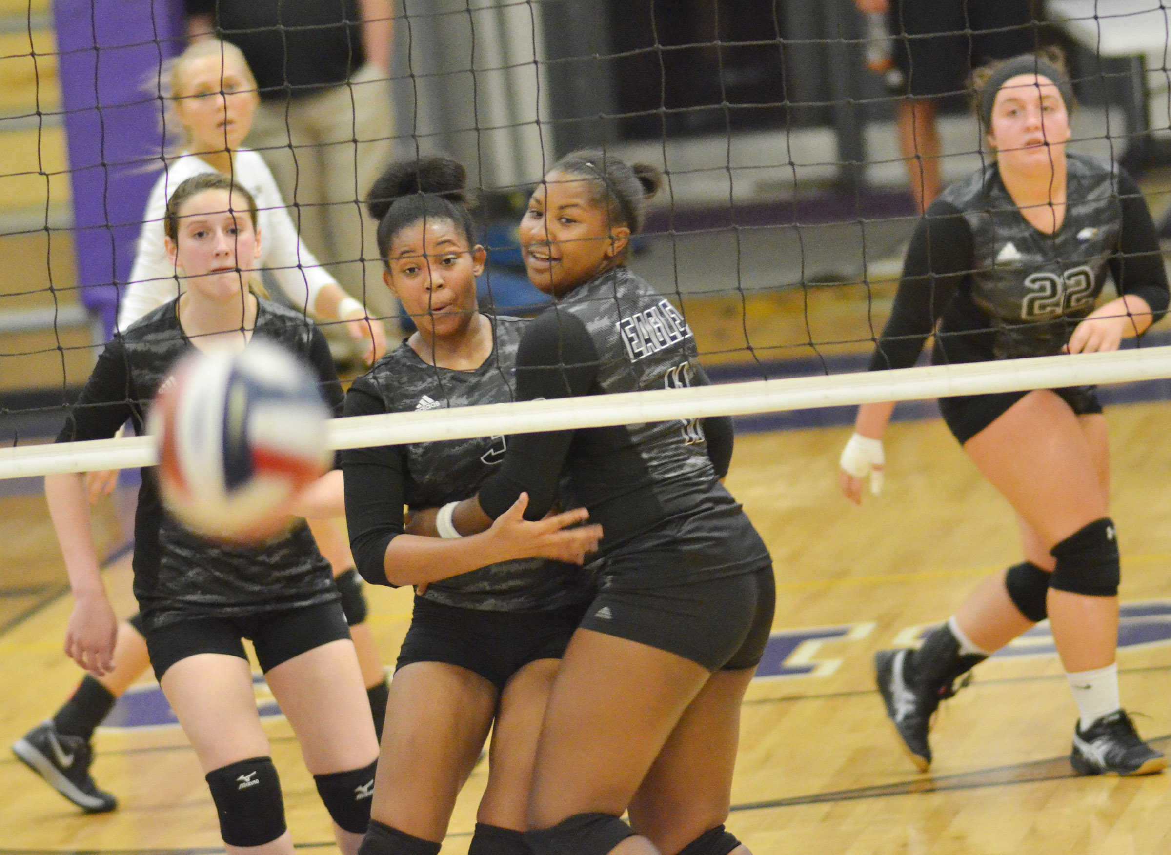 CHS seniors Vonnea Smith, center, and Kiyah Barnett collide as they watch the ball.