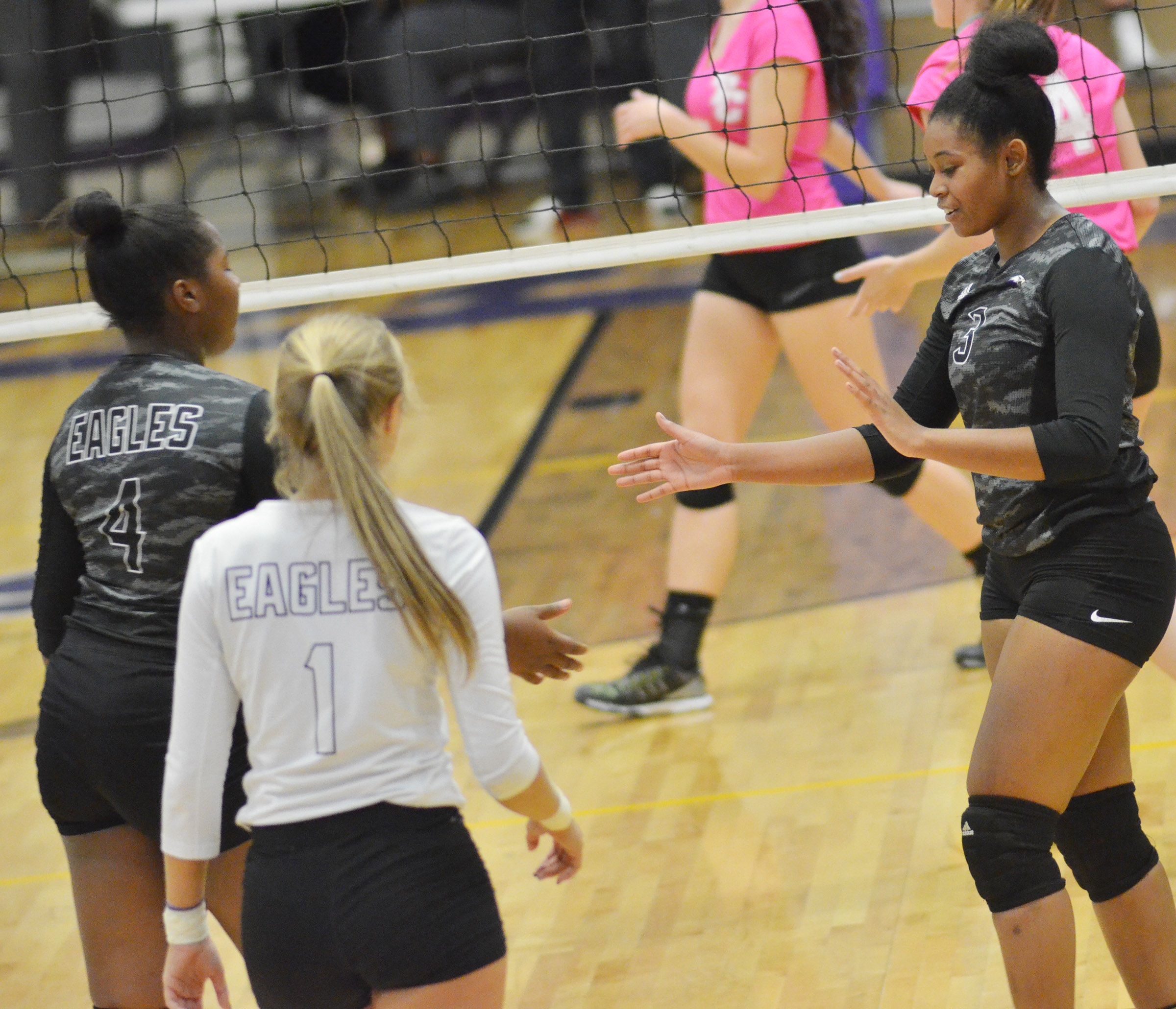 CHS senior Vonnea Smith, at right, celebrates a point with her teammates.