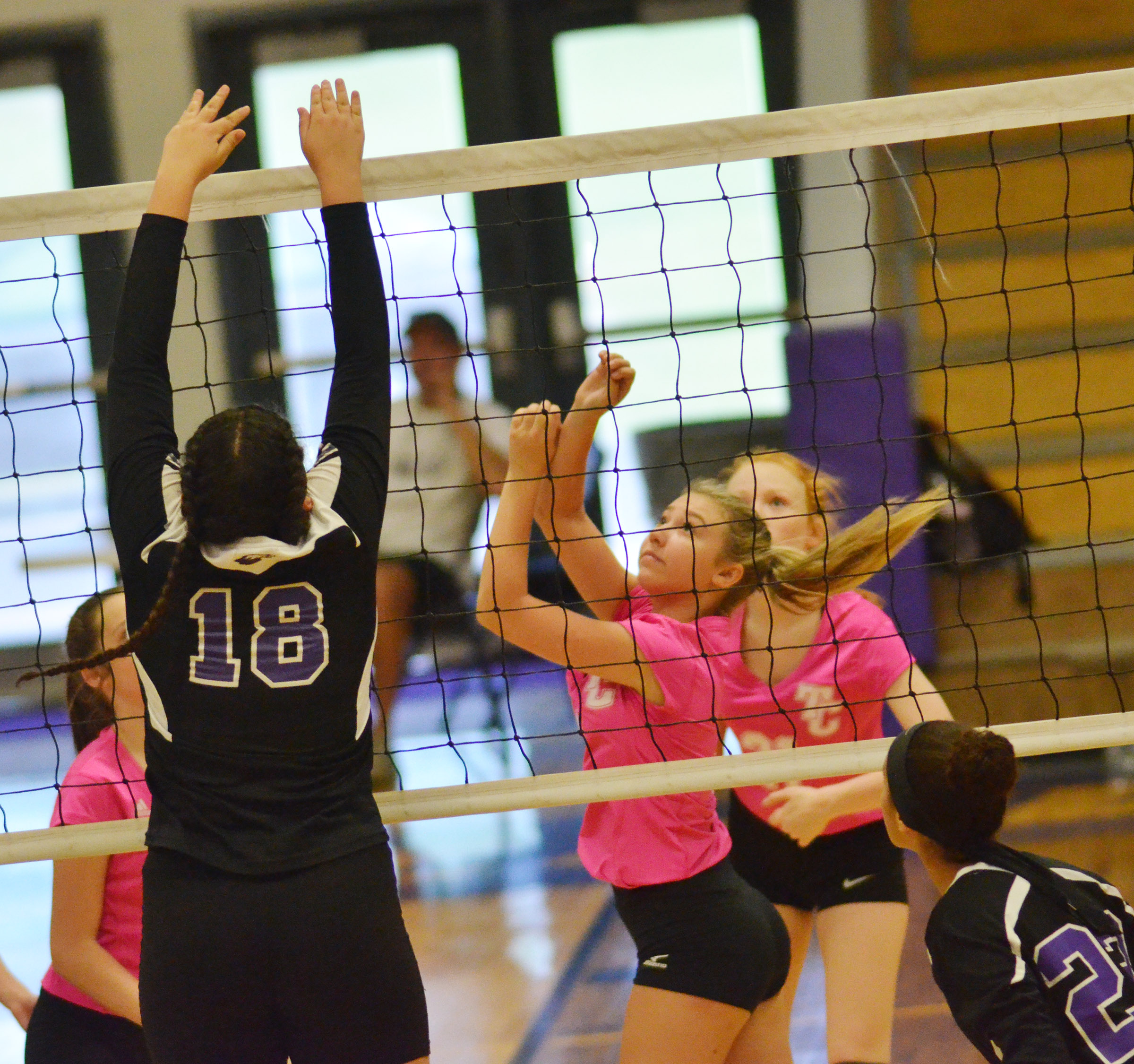 CHS freshman Anna Clara Moura jumps to block a shot.