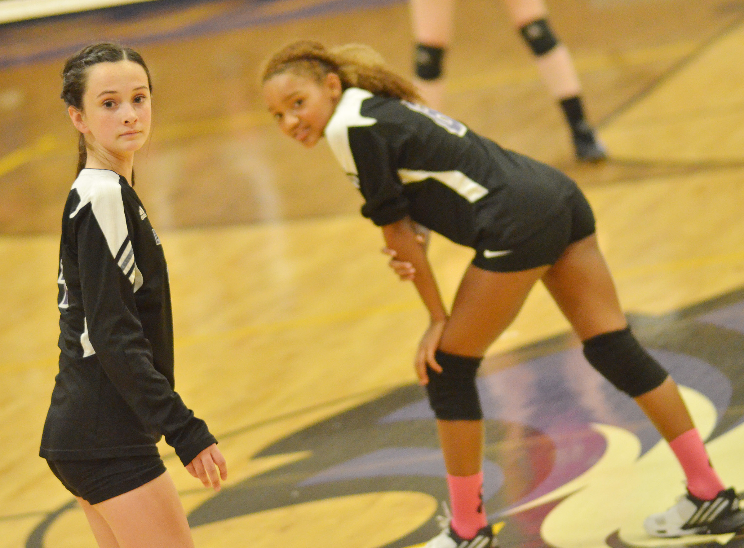 Campbellsville Middle School eighth-grader Sara Adkins, at left, and classmate Alexis Thomas wait for the serve.