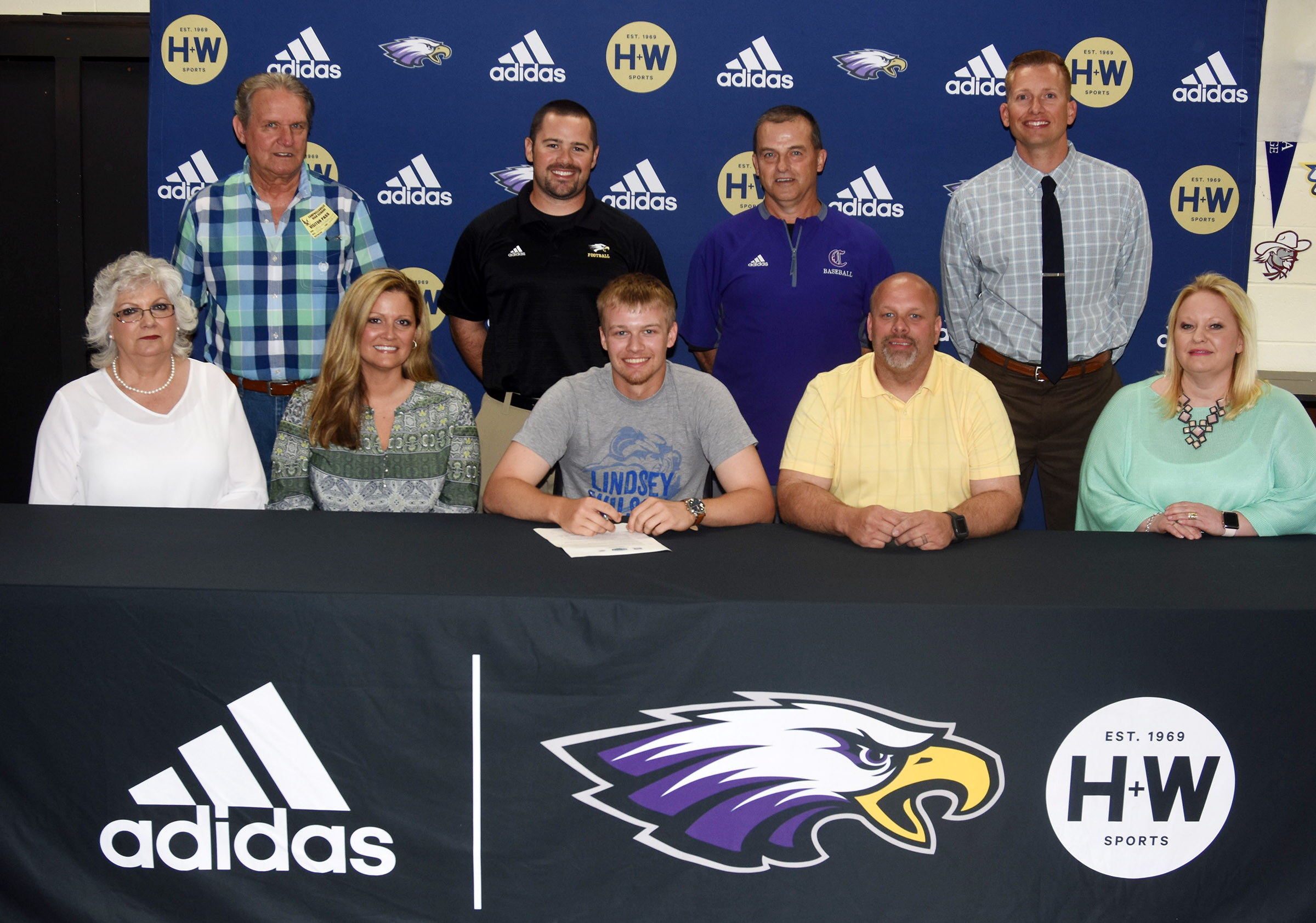 Campbellsville High School senior baseball player Wyatt Houk will continue his academic and athletic career at Lindsey Wilson College. He recently celebrated his signing with his family, friends, teammates and coaches. From left, front, are his grandmother Teresa Morgan, his mother Kristie Graybeal, Houk, his father Josh Houk and stepmother Brooke Houk. In back are his grandfather Steve Morgan, CHS baseball head coach Blake Milby and assistant coaches Lynn Kearney and Zach Lewis. Not pictured is Houk's stepfather Chris Graybeal.