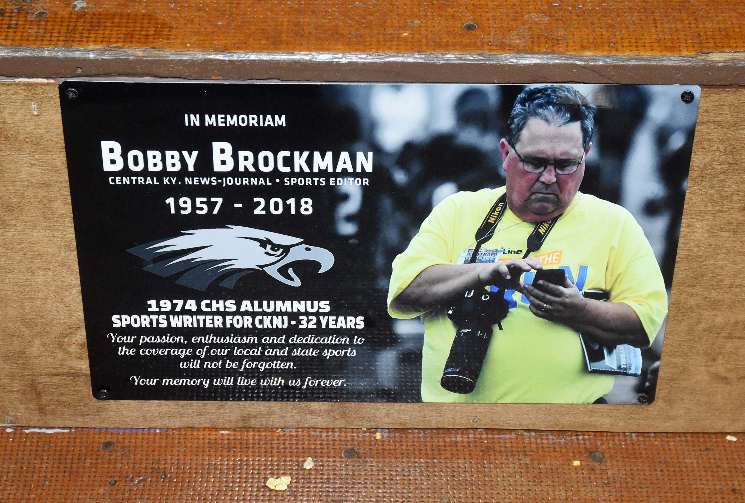 The section of bleachers where the late Bobby Brockman always sat in the CHS gym has been removed, and a plaque has been hung in its place.