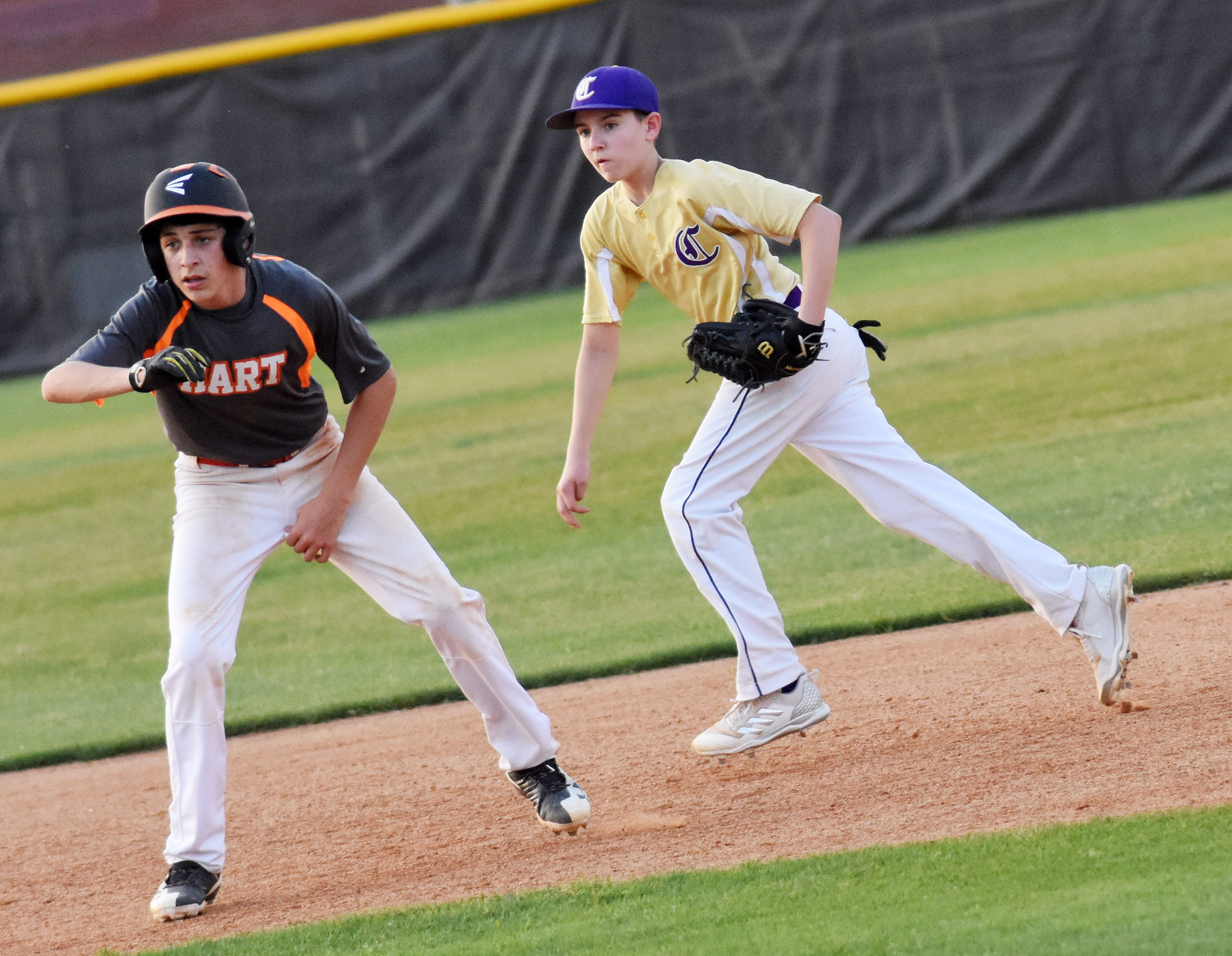 CMS seventh-grader Bryce Newton keeps the runner close at second.