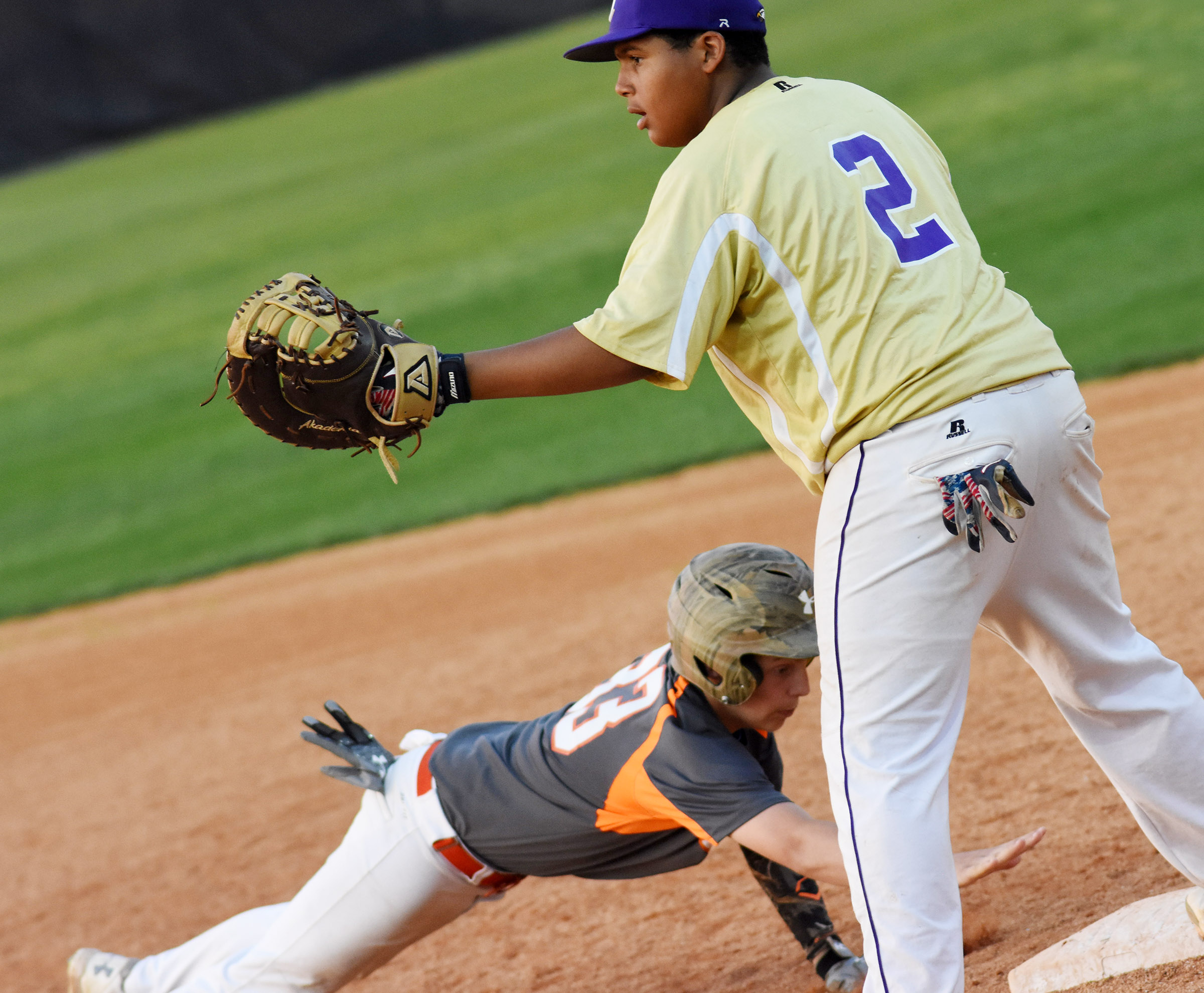 CMS seventh-grader J.T. Washington keeps the runner close at first.