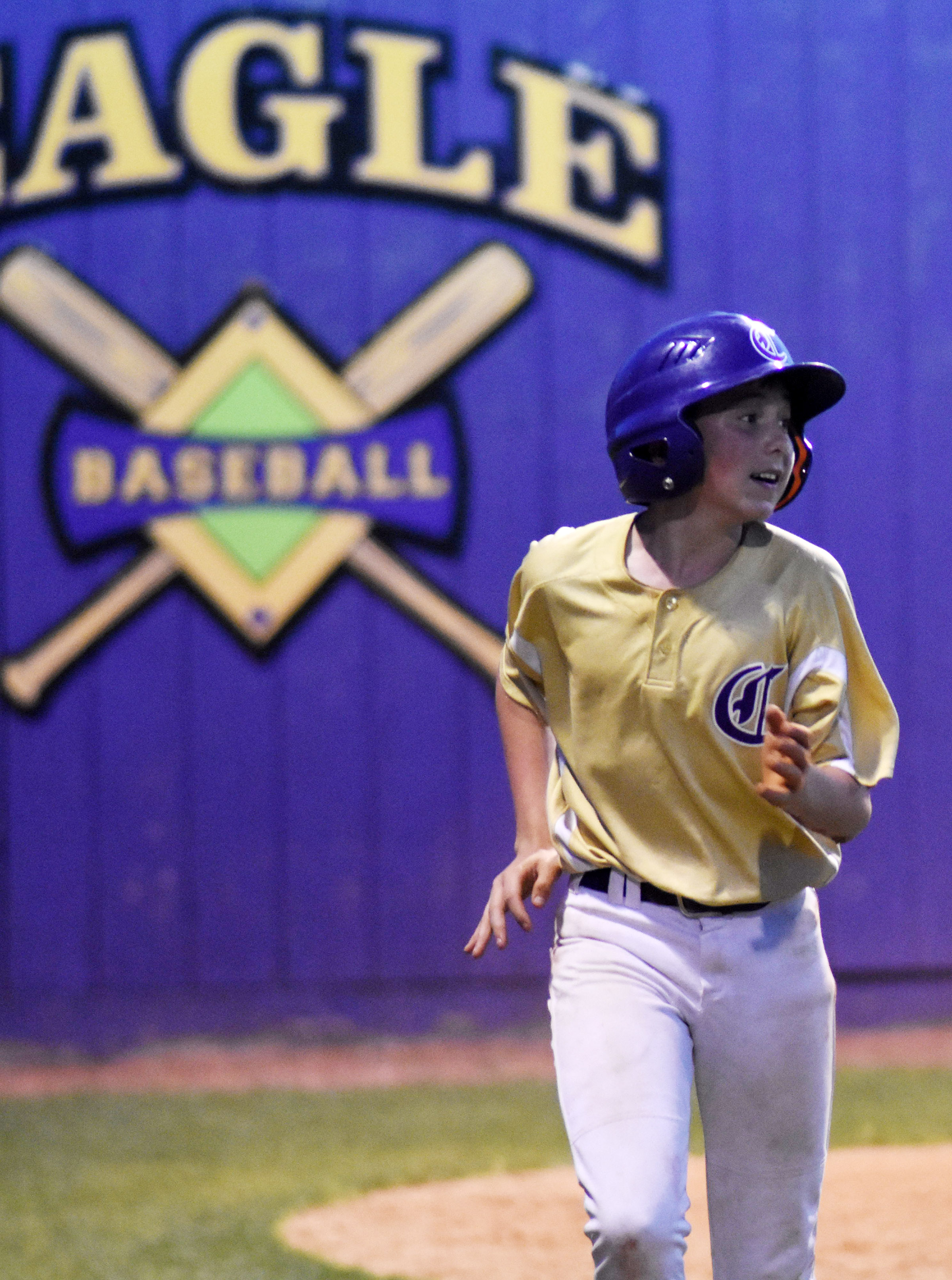 CMS eighth-grader Dakota Harris runs to the dugout after scoring a run.