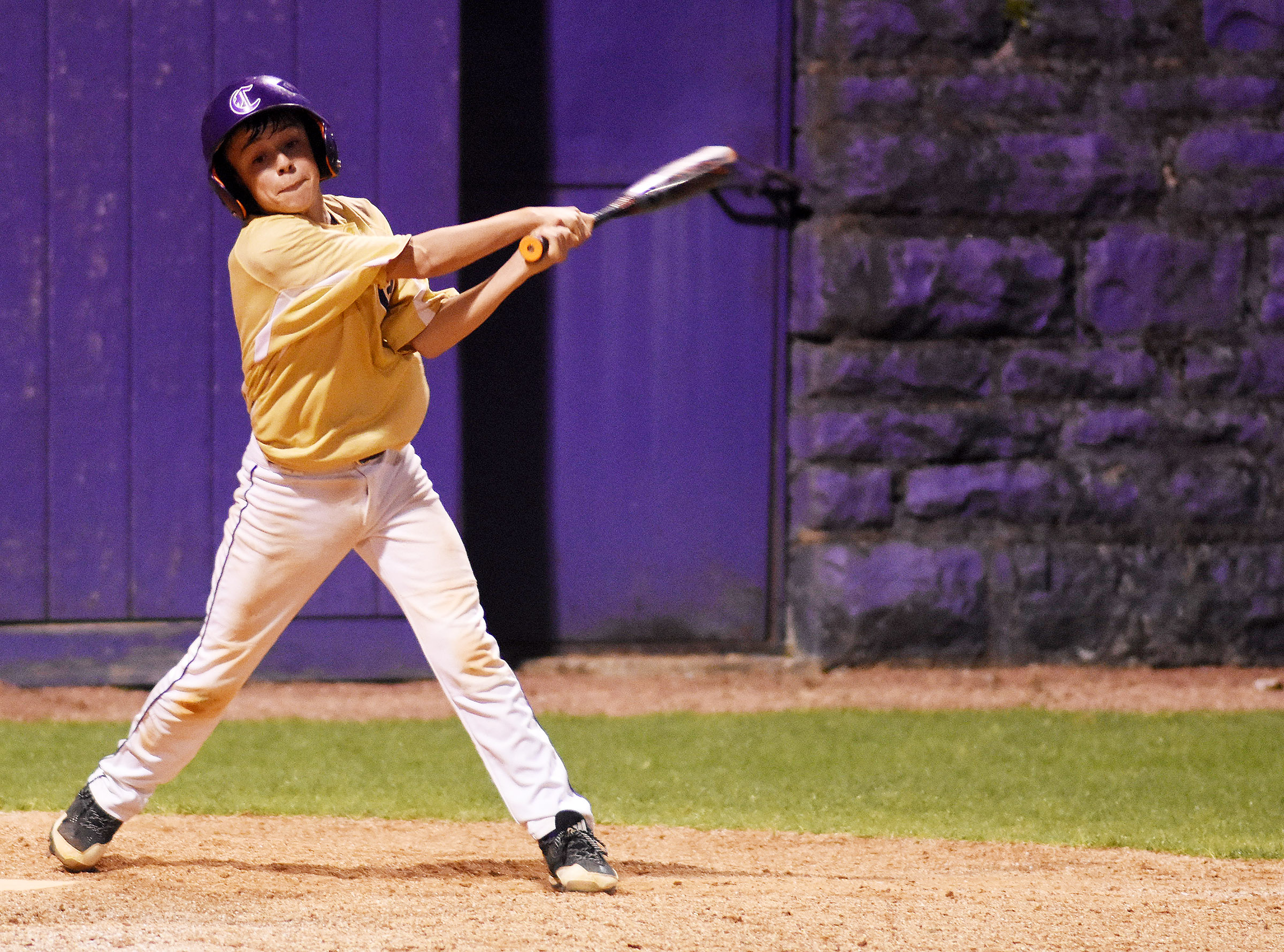 CMS seventh-grader Chase Hord swings at a pitch.