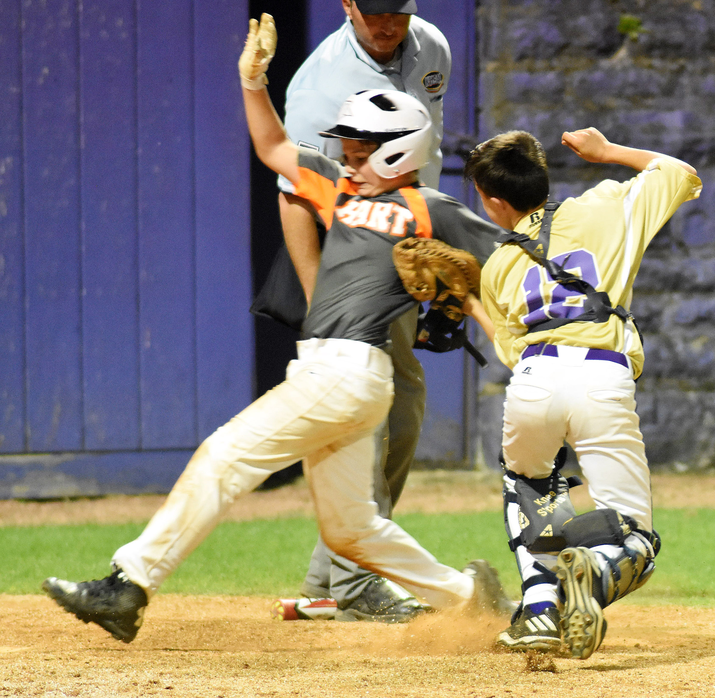 CMS seventh-grader Chase Hord tags a runner out at home.