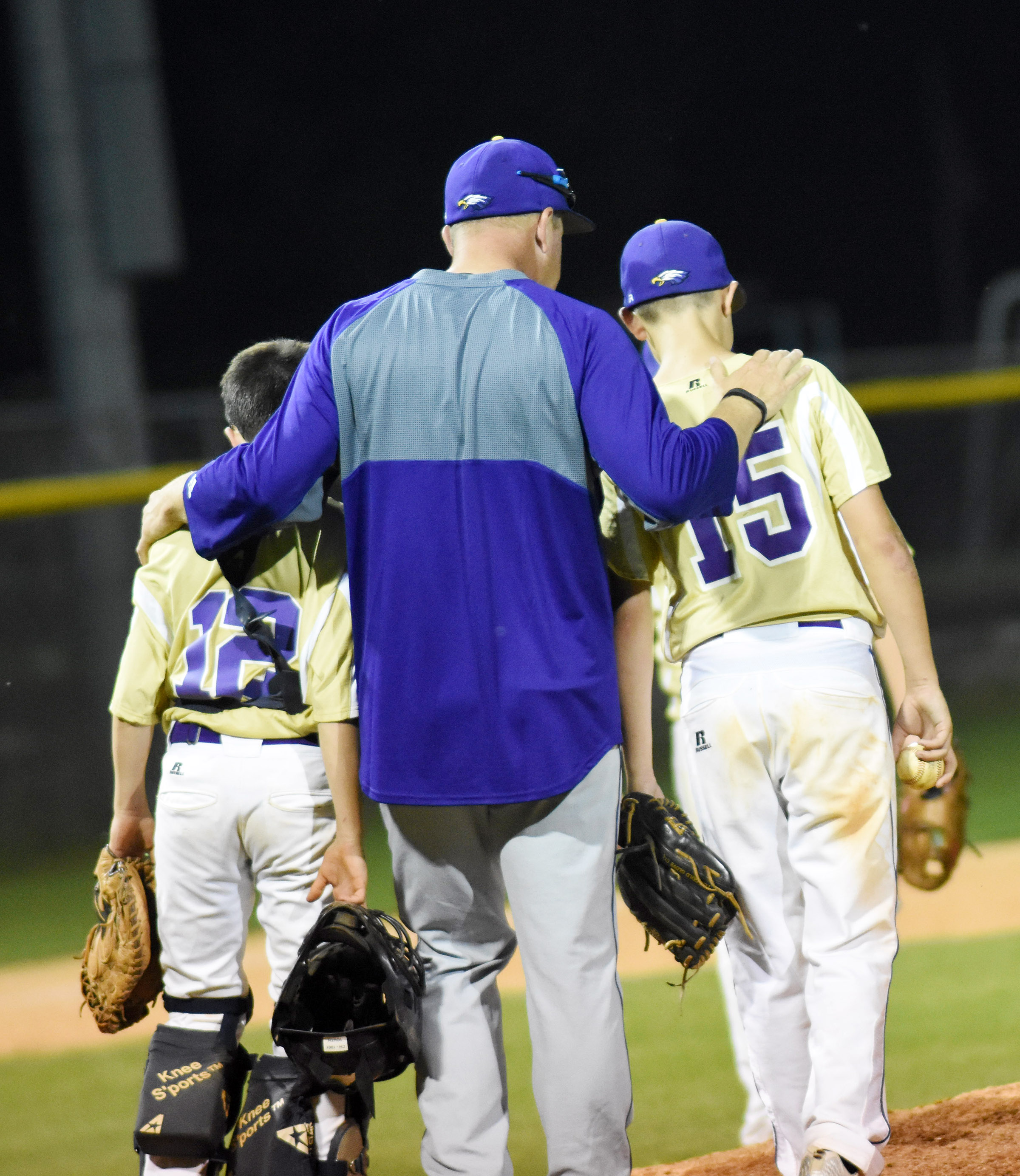 CMS baseball assistant coach Bradley Bates talks to catcher Chase Hord, a seventh-grader, at left, and pitcher Kaden Bloyd, a sixth-grader.