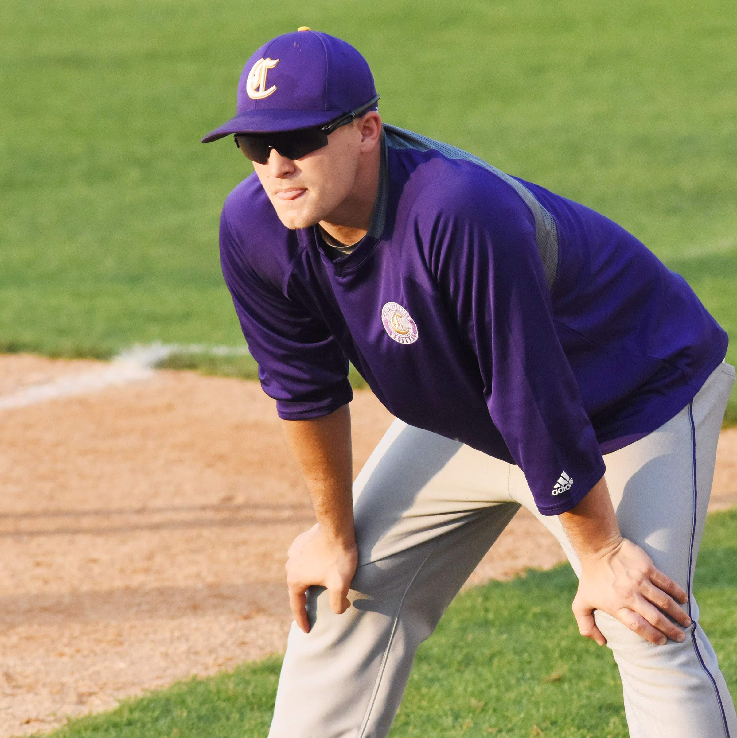 CMS baseball assistant coach Bradley Bates watches his players.