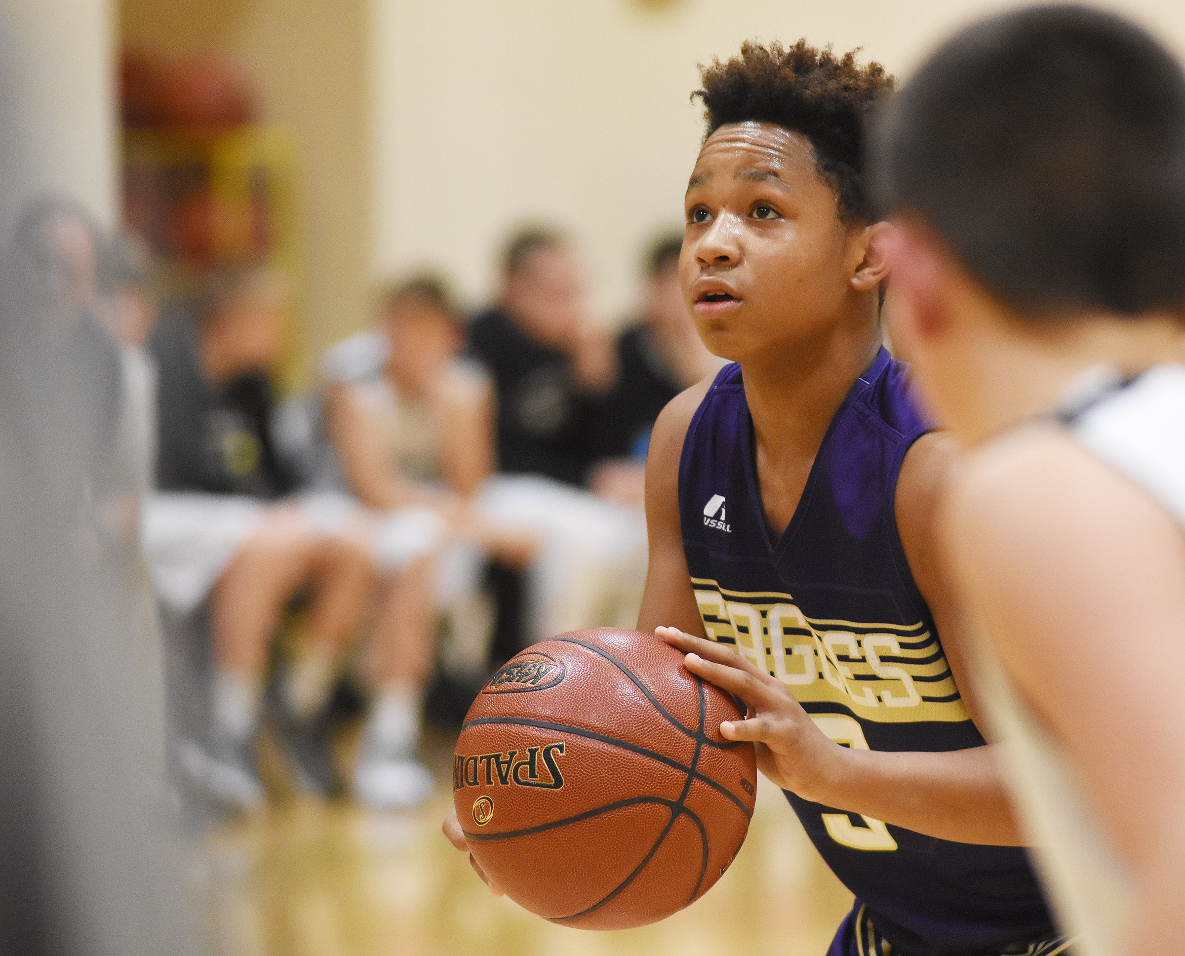 CMS seventh-grader Deondre Weathers shoots the ball.