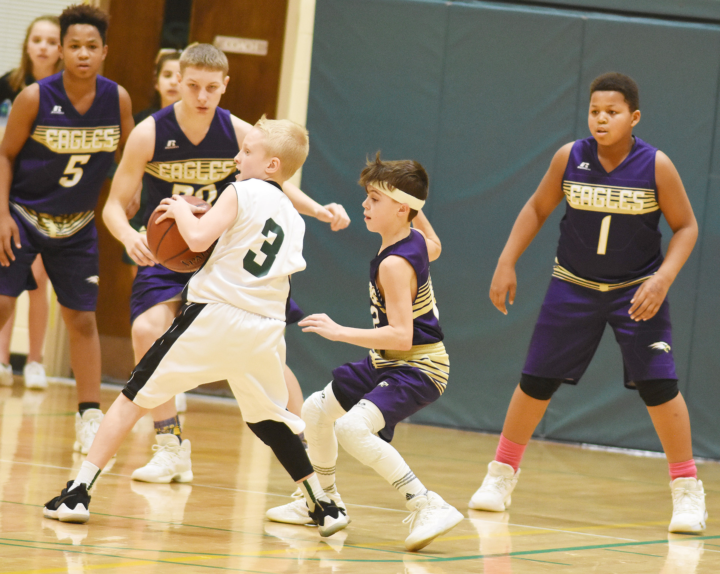 From left, CMS seventh-graders Deondre Weathers, Damon Johnson, Chase Hord and Keondre Weathers play defense.