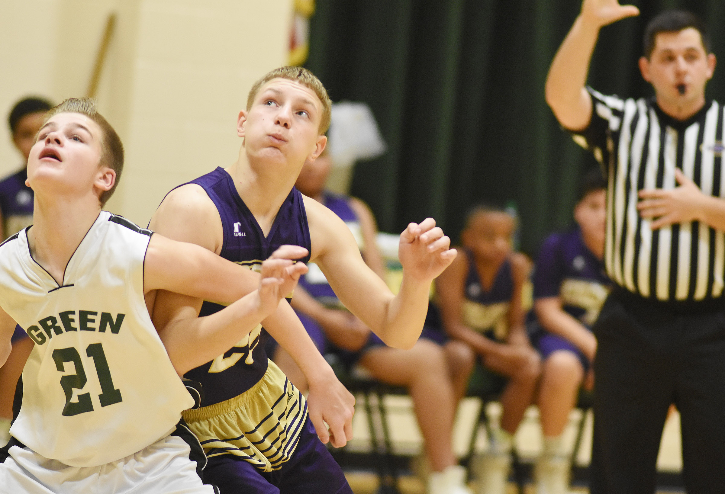 CMS seventh-grader Damon Johnson fights for the ball.