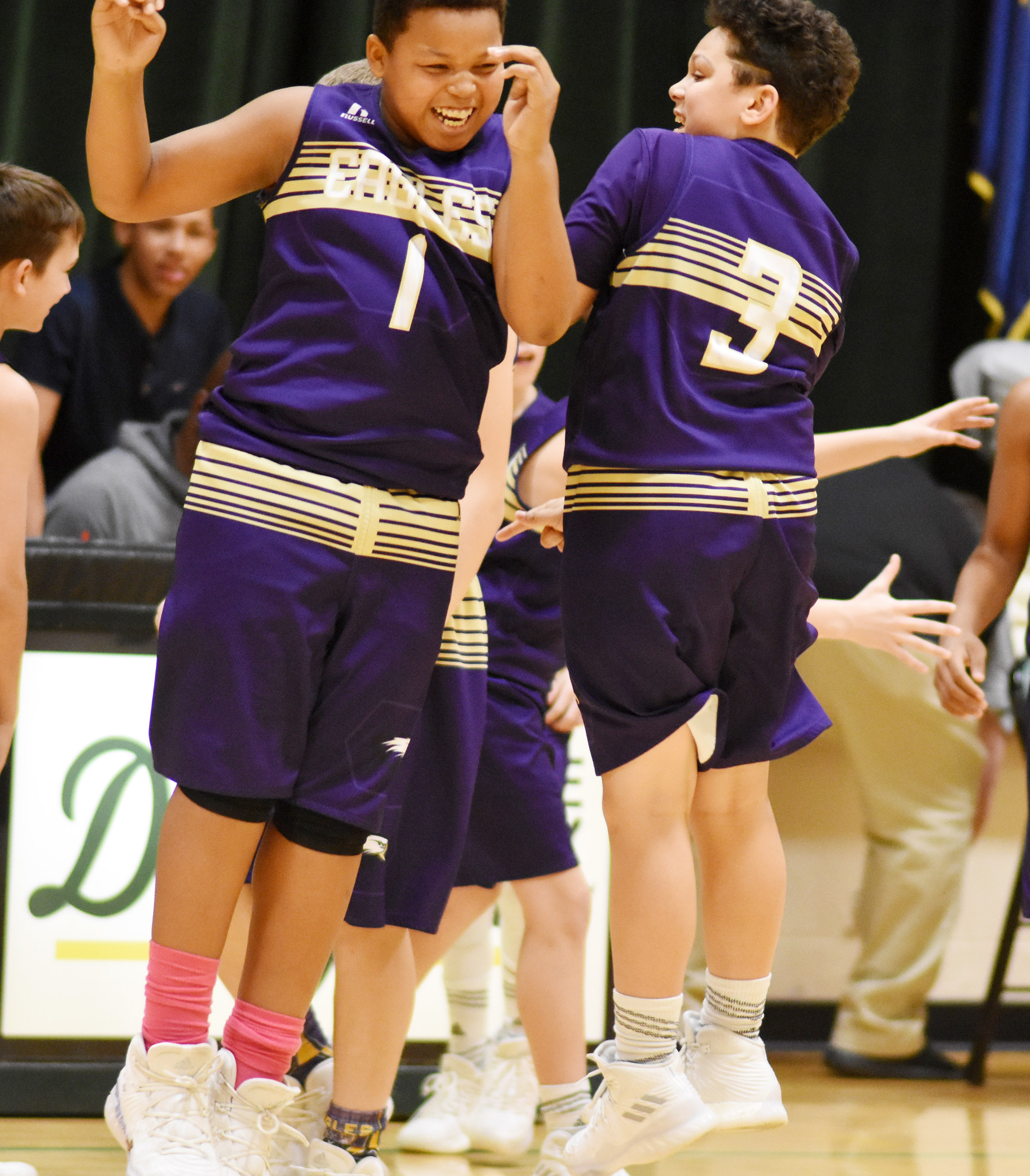 CMS seventh-graders Keondre Weathers, at left, and Kaydon Taylor celebrate as their game goes into overtime.
