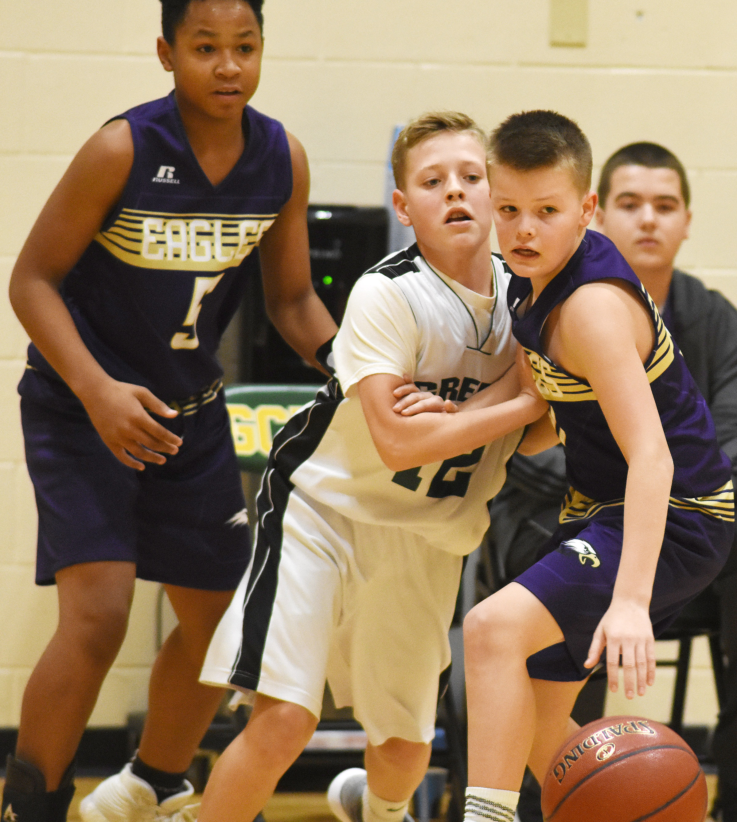 CMS seventh-grader Konner Forbis gets the ball.