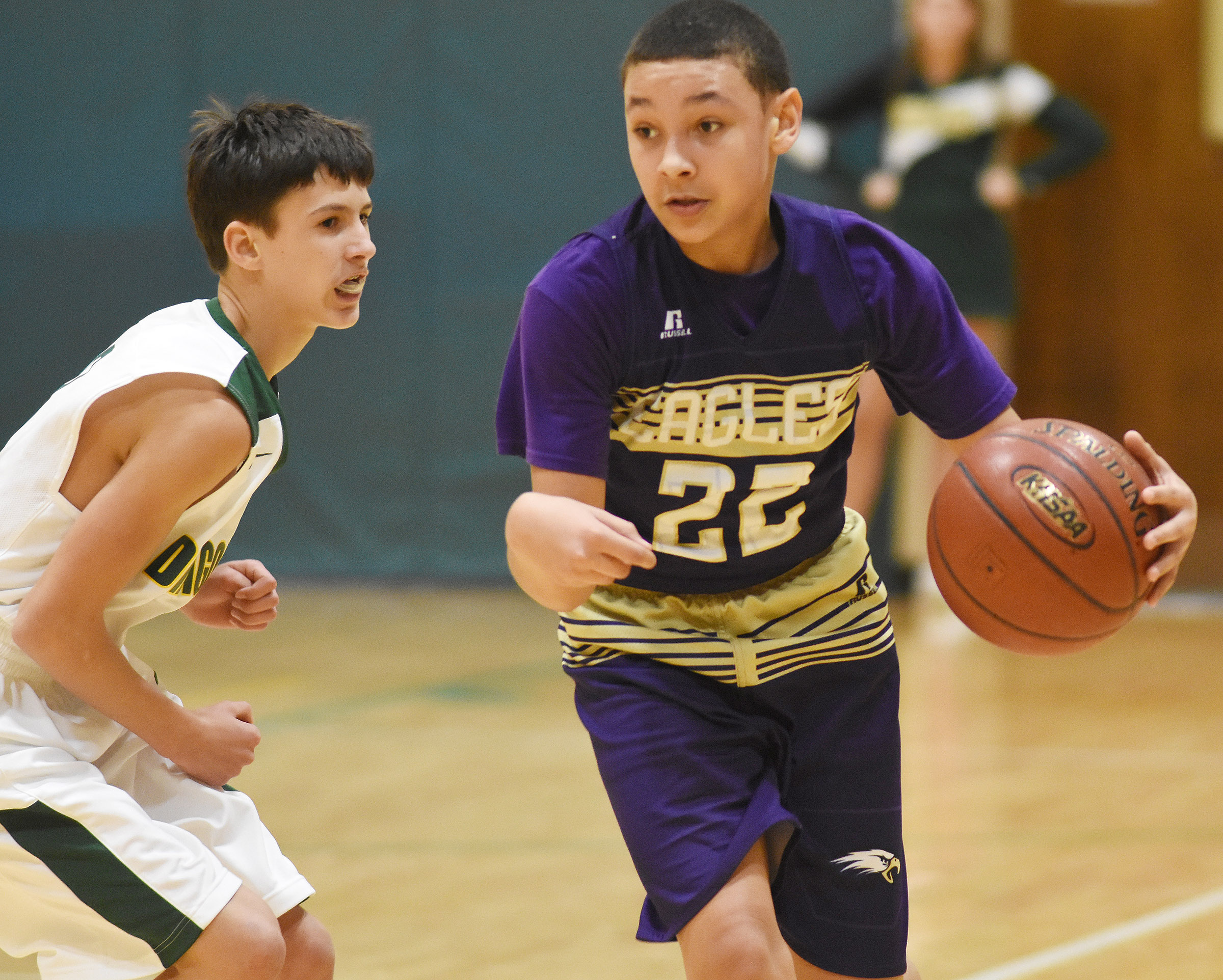 CMS eighth-grader Brice Spaw dribbles to the basket.