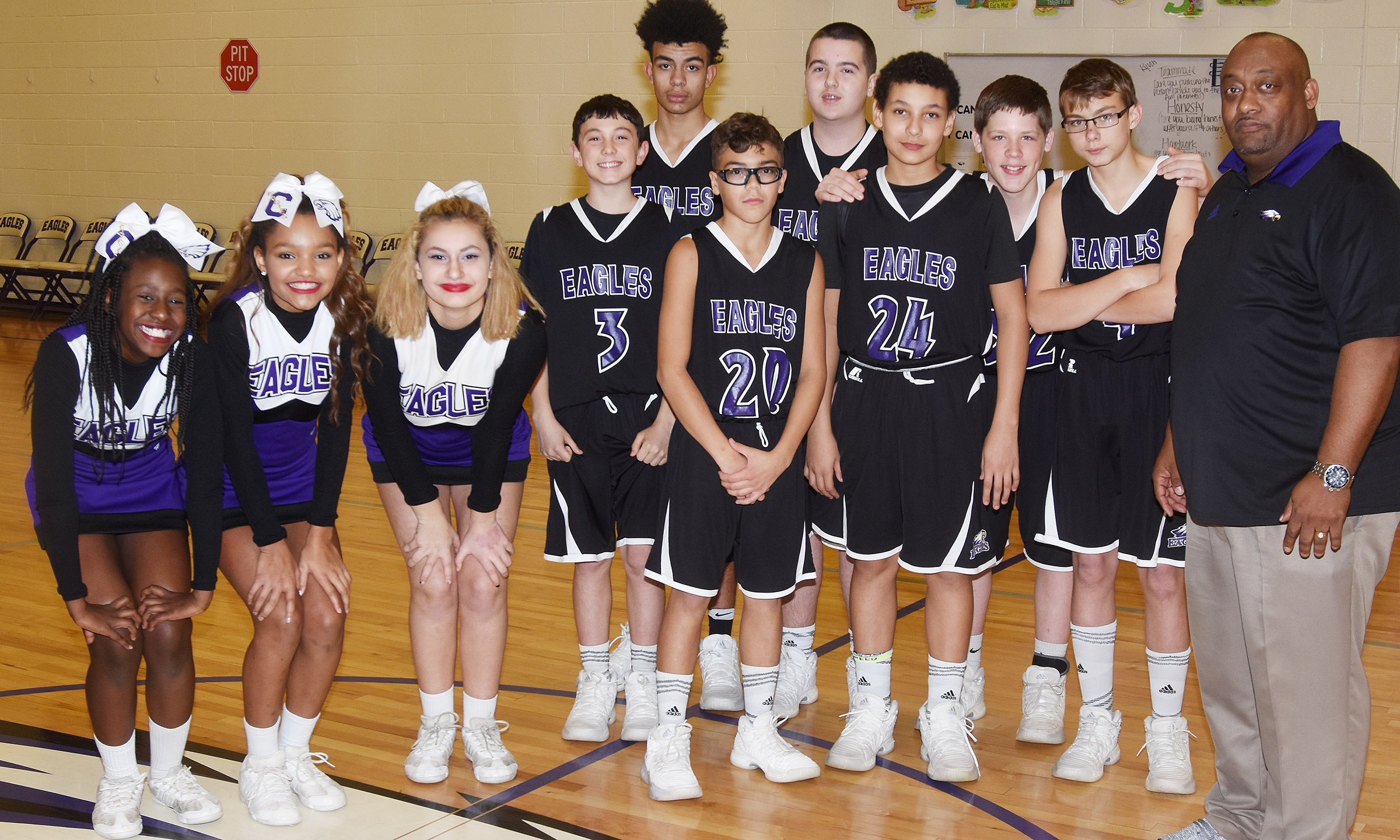 Campbellsville Middle School eighth-grade boys' basketball players and cheerleaders were honored on Thursday, Jan. 4. From left are cheerleaders Myricle Gholston, Alexis Thomas and Christina Miller, basketball players Dakota Harris, Adrien Smith, Logan Phillips, Jack Sabo, Brice Spaw, Josh Lucas, Jarred Mays and coach Joseph Taylor.