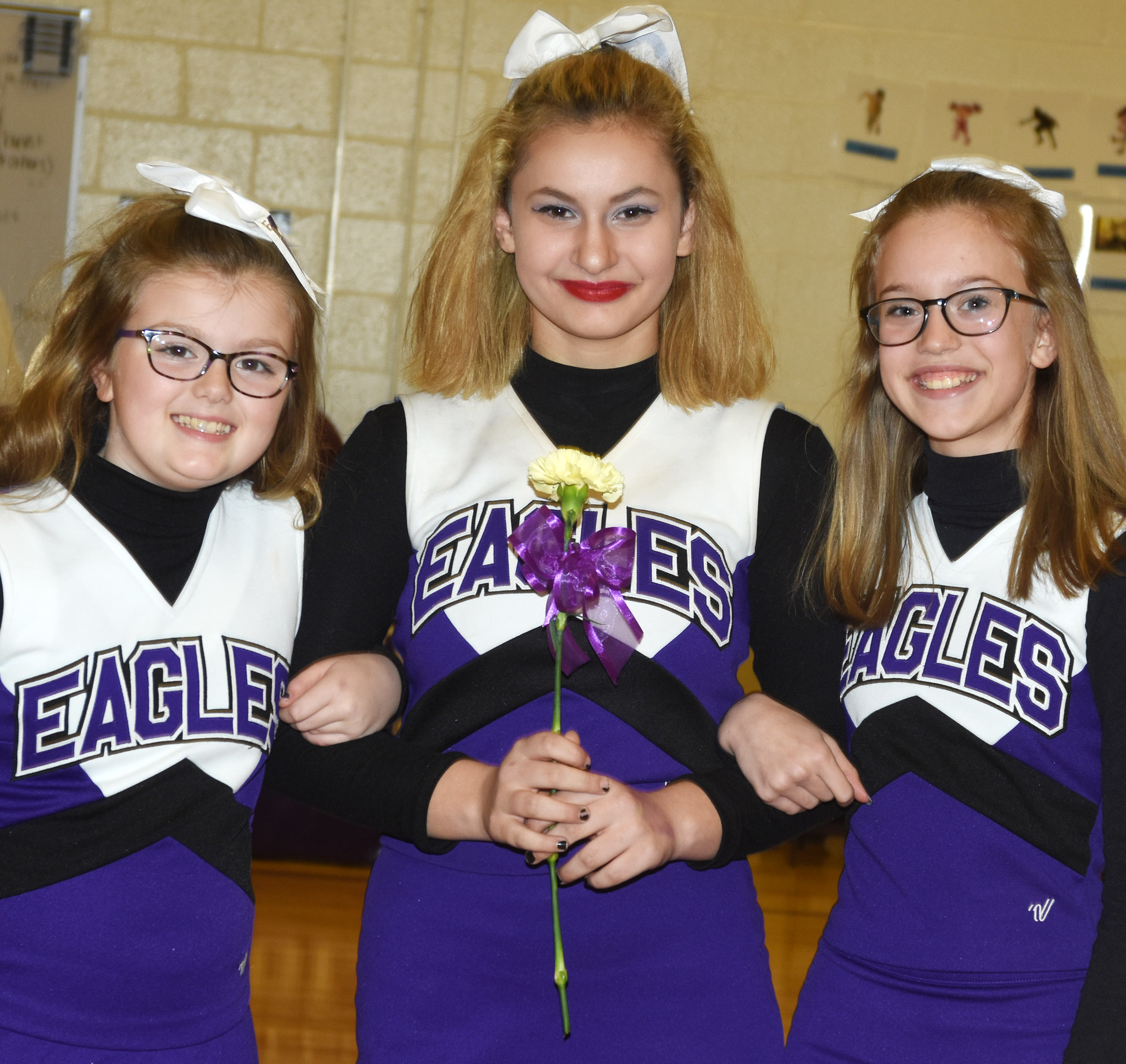 CMS eighth-grade cheerleader Christina Miller is honored.
