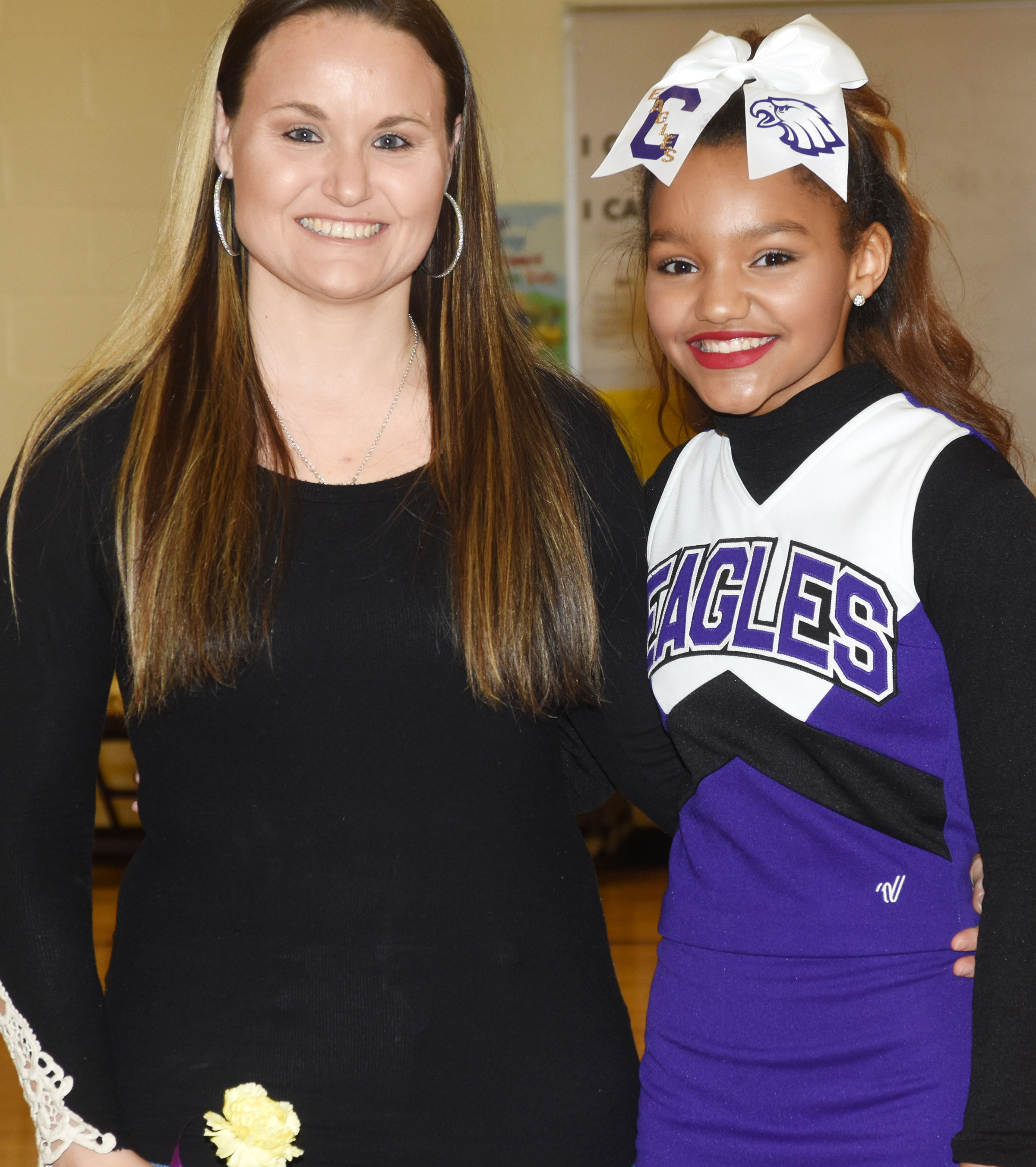 CMS eighth-grade cheerleader Alexis Thomas is honored.