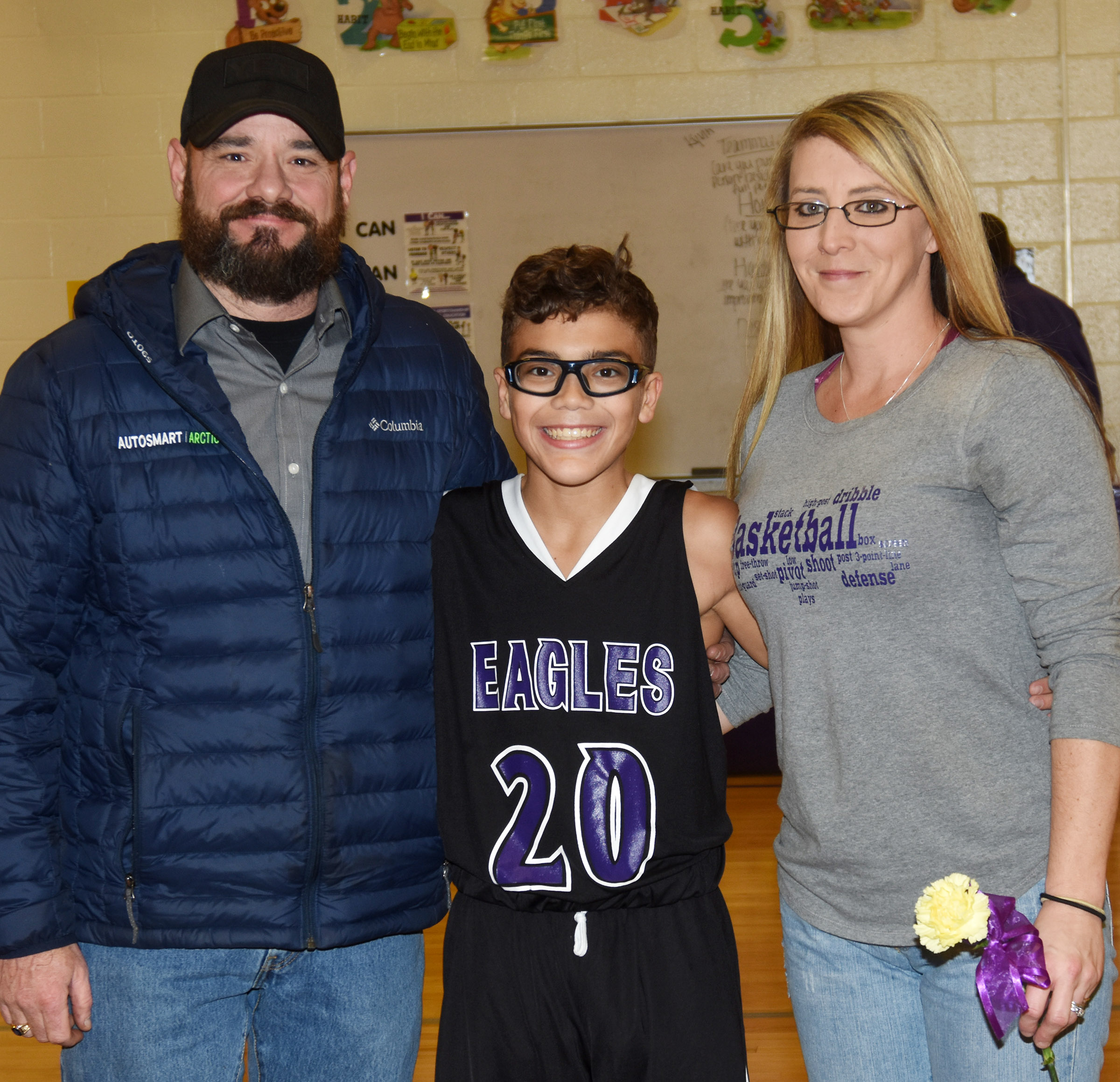 CMS boys' basketball eighth-grader Logan Phillips is honored.