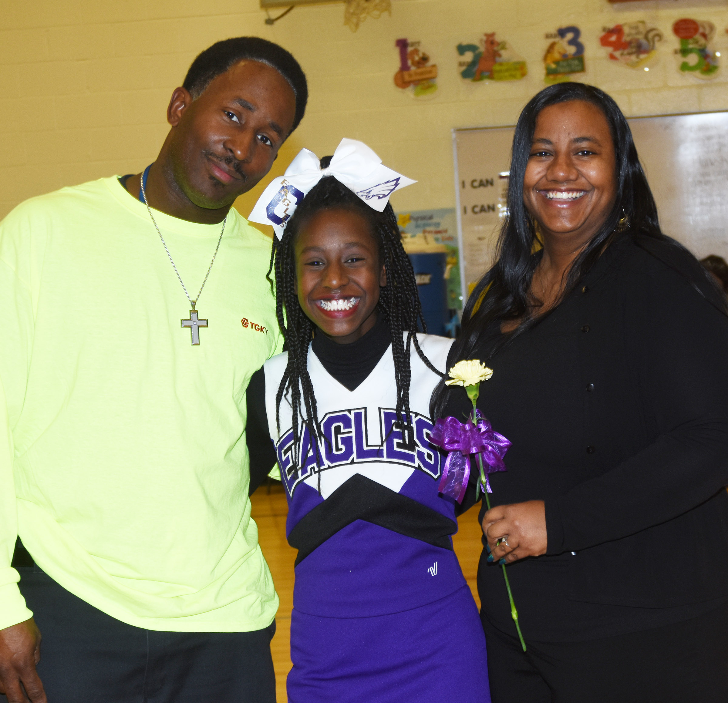 CMS eighth-grade cheerleader Myricle Gholston is honored.