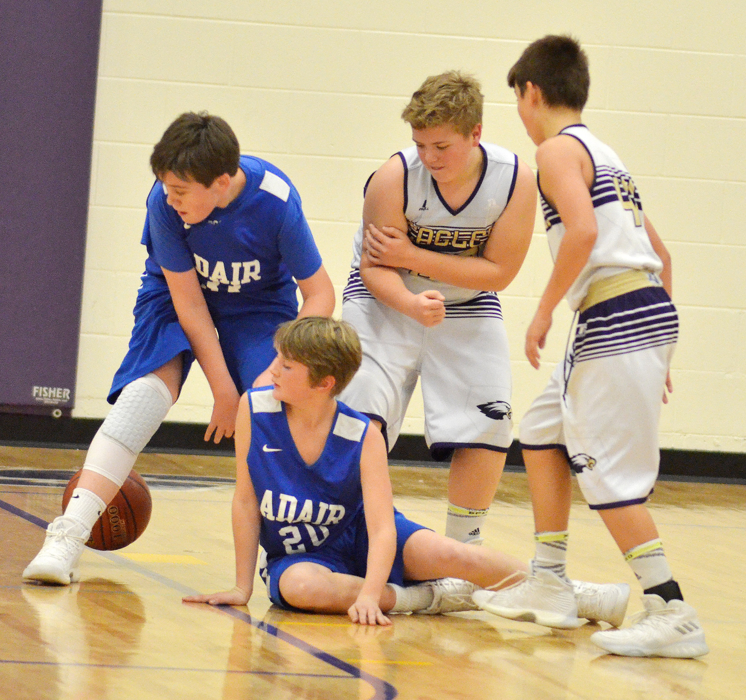 CMS sixth-graders Ryan Grubbs, at left, and Kaden Bloyd fight for the ball.