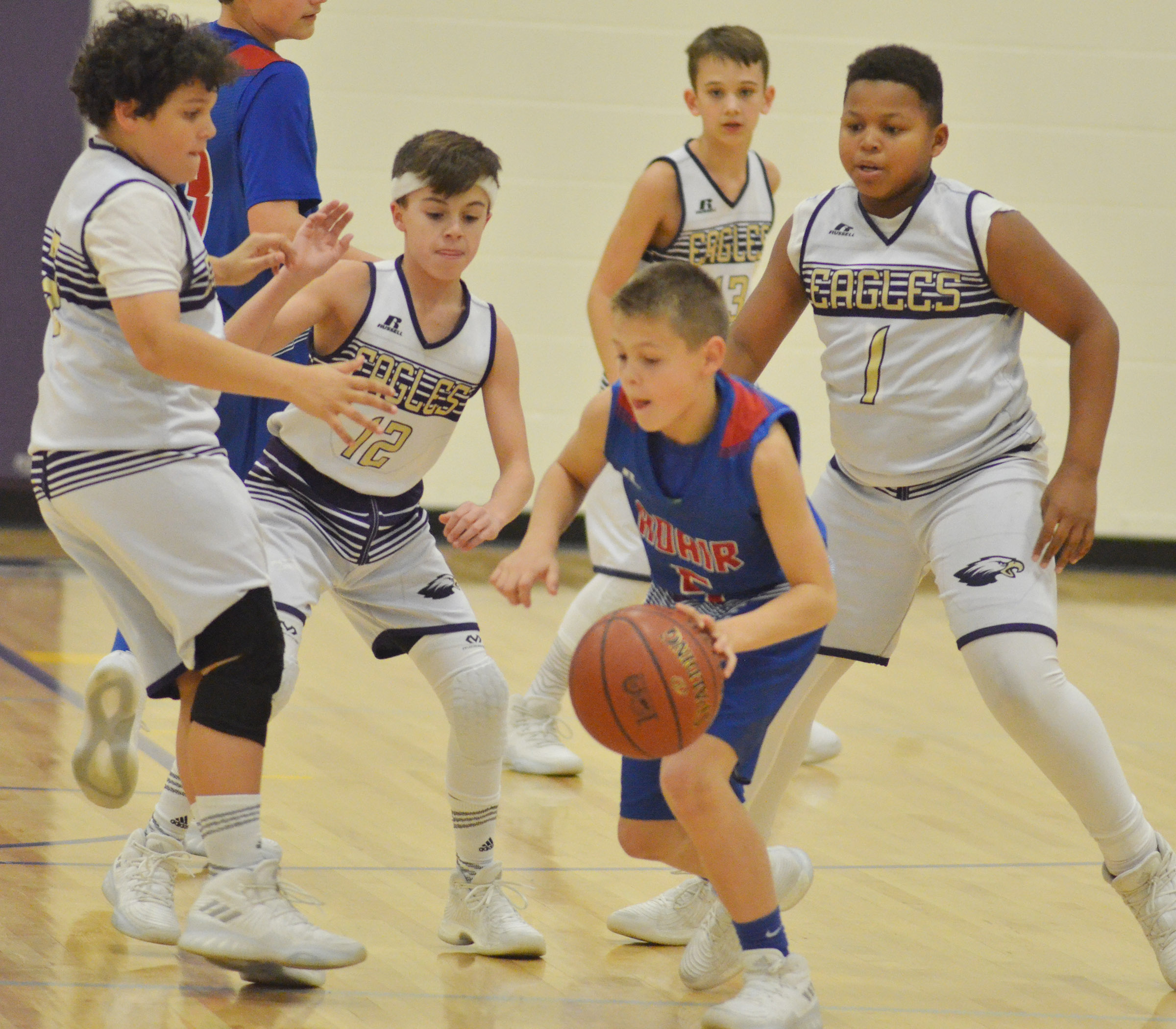 From left, CMS seventh-graders Kaydon Taylor, Chase Hord, Camren Vicari and Keondre Weathers play defense.