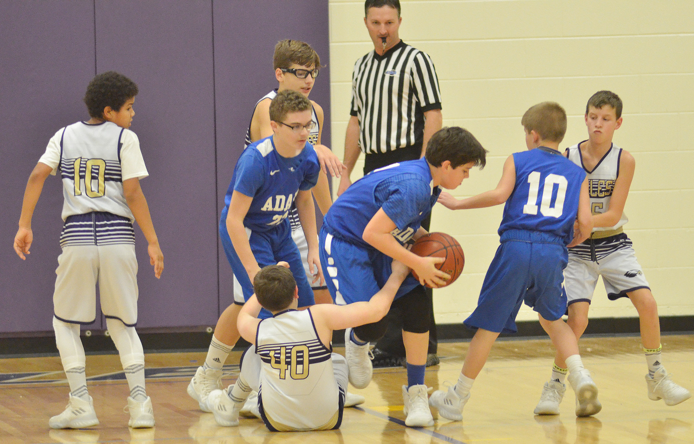 From left, CMS sixth-grader Tashaun Hart and Campbellsville Elementary School fifth-graders Dalton Morris, Andrew Mardis and Rowan Petett fight for the ball.
