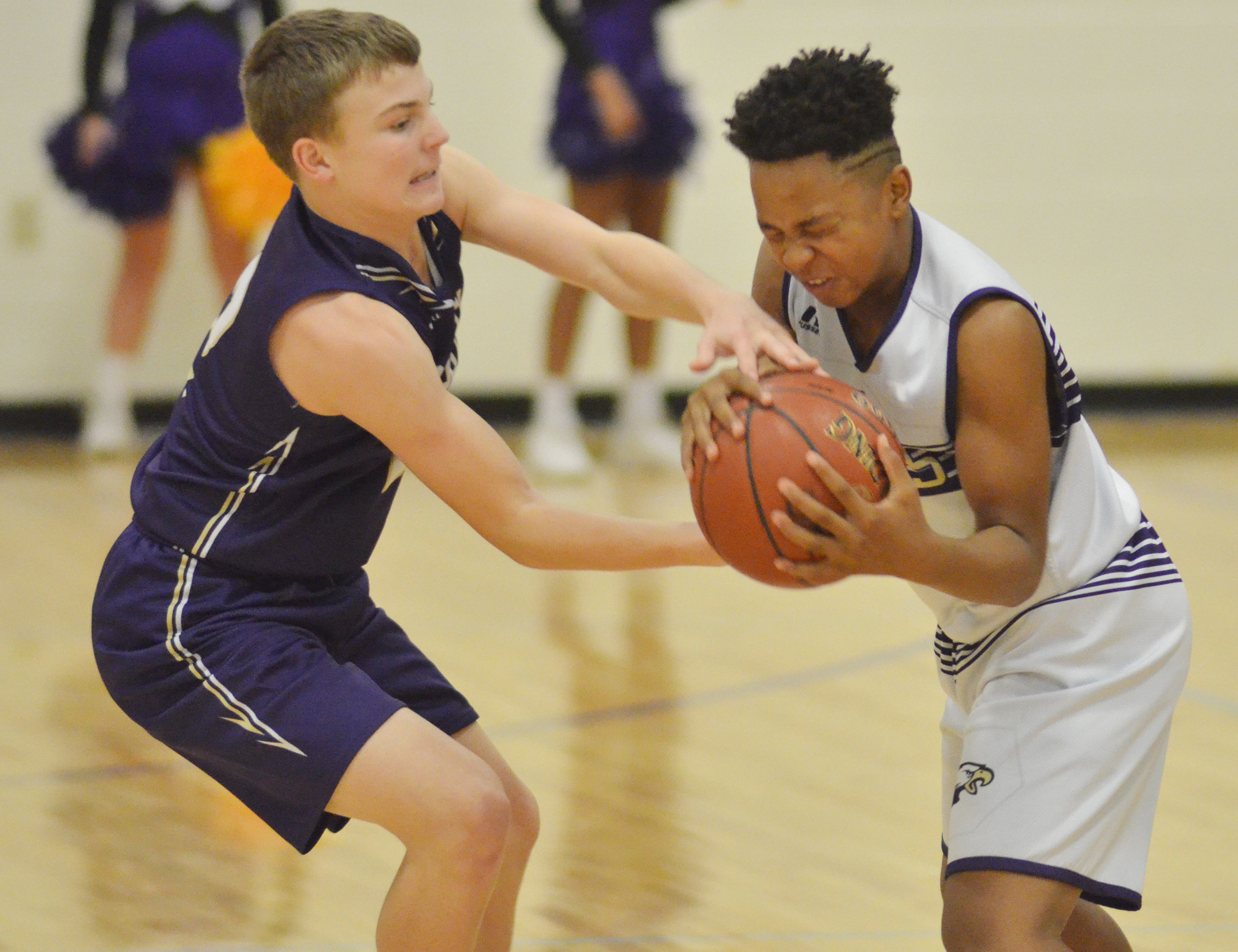 CMS seventh-grader Deondre Weathers fights for the ball.
