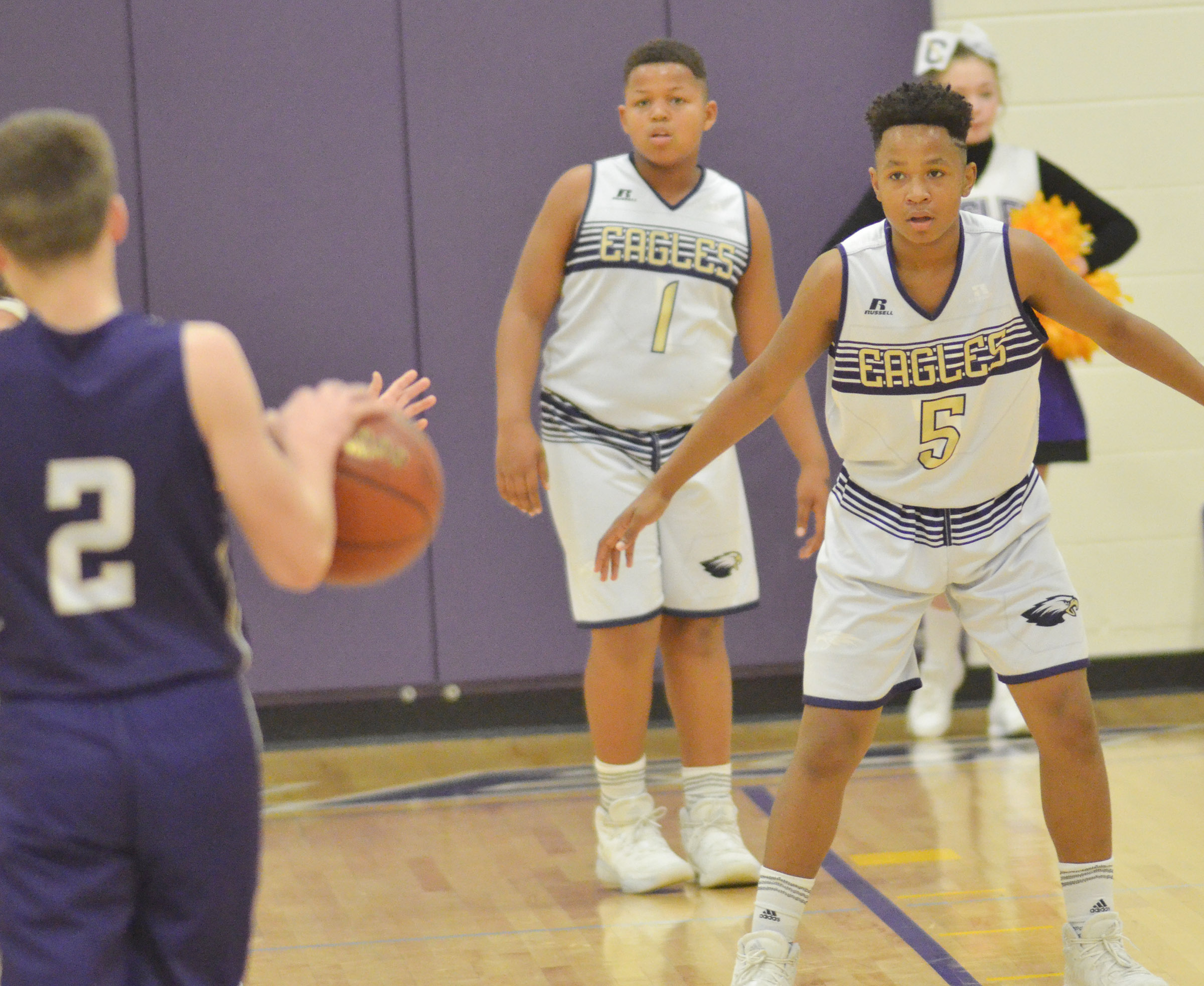 CMS seventh-graders Keondre Weathers, at left, and his brother Deondre Weathers play defense.