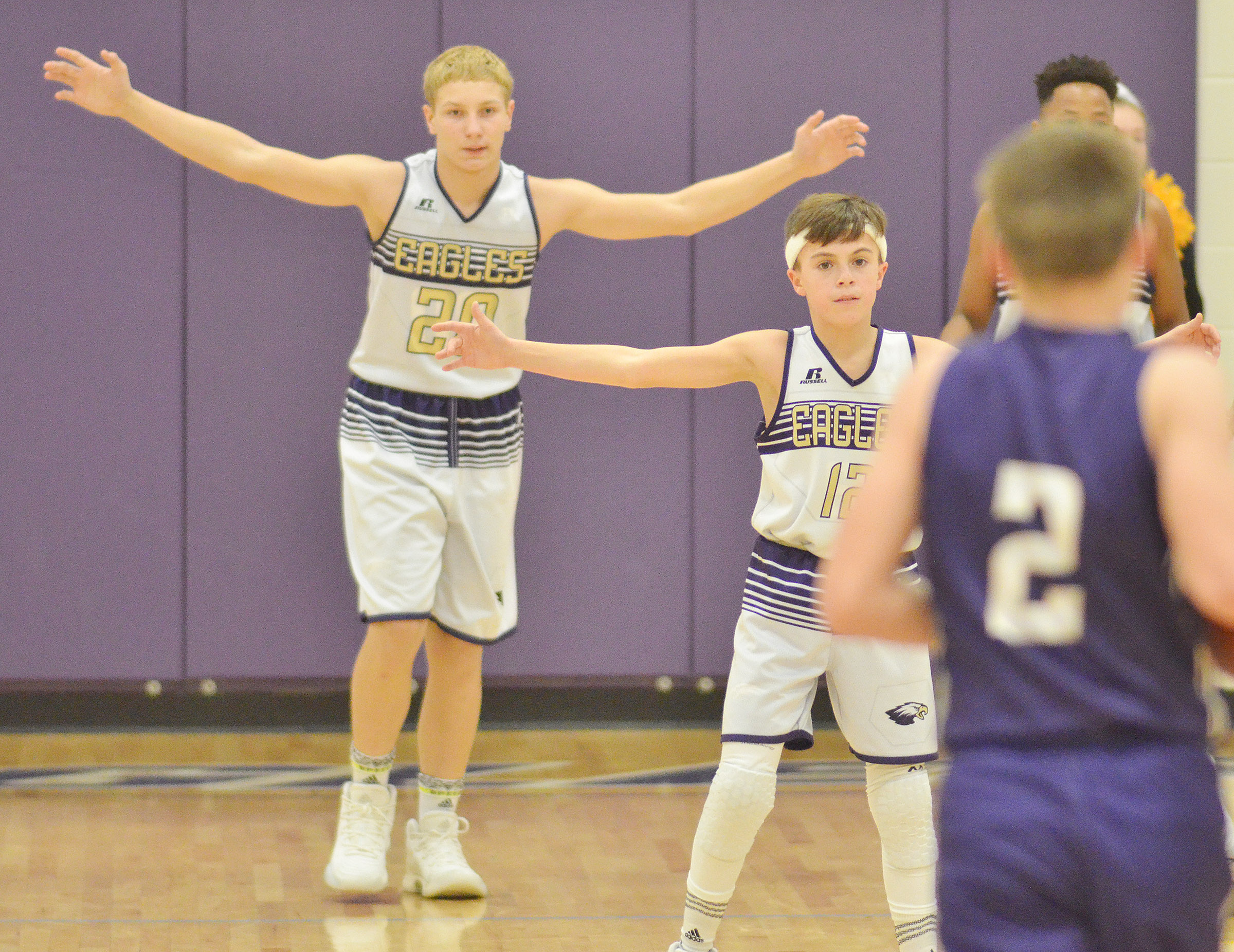CMS seventh-graders Damon Johnson, at left, and Chase Hord play defense.