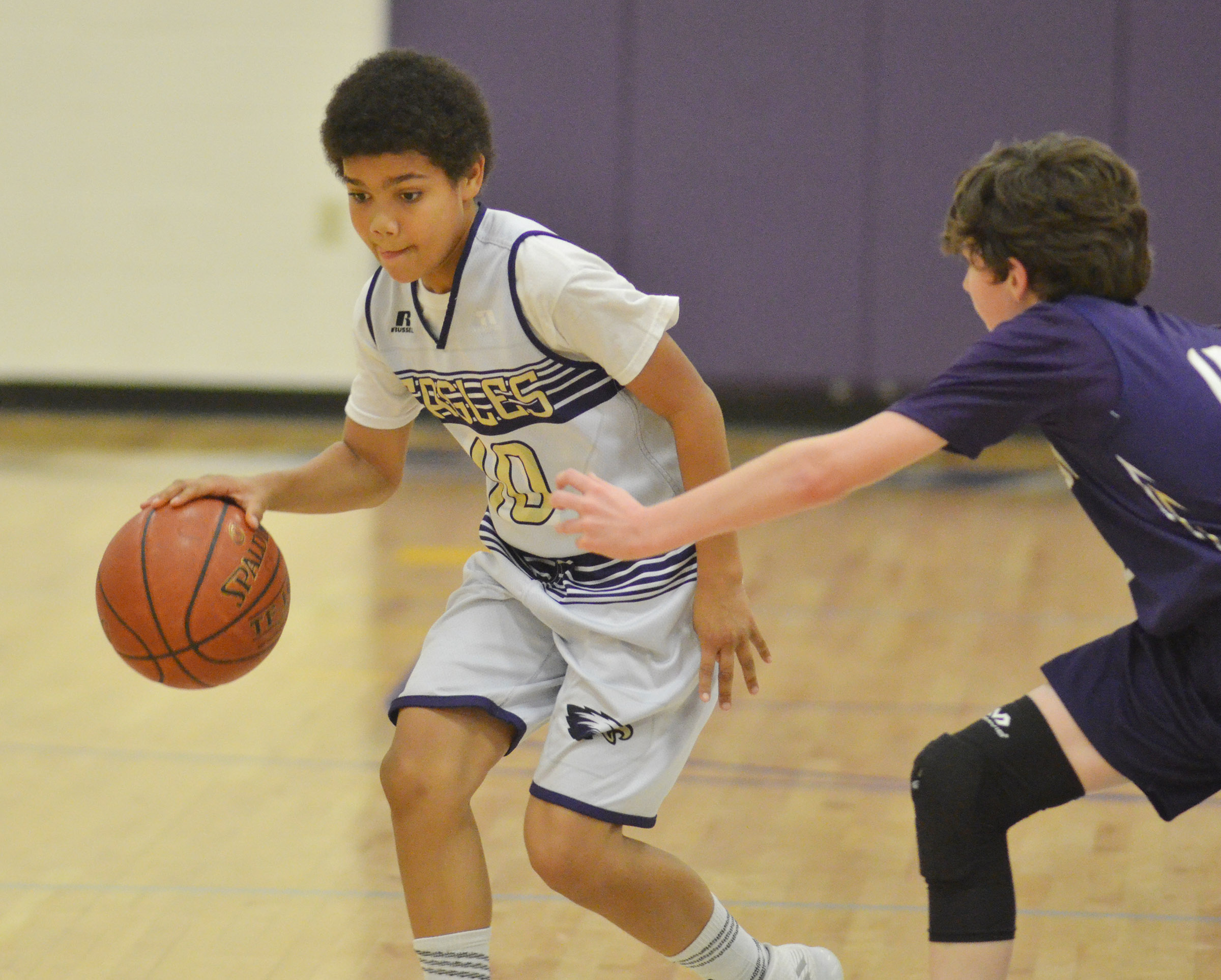 CMS sixth-grader Tashaun Hart dribbles around a Bardstown defender.