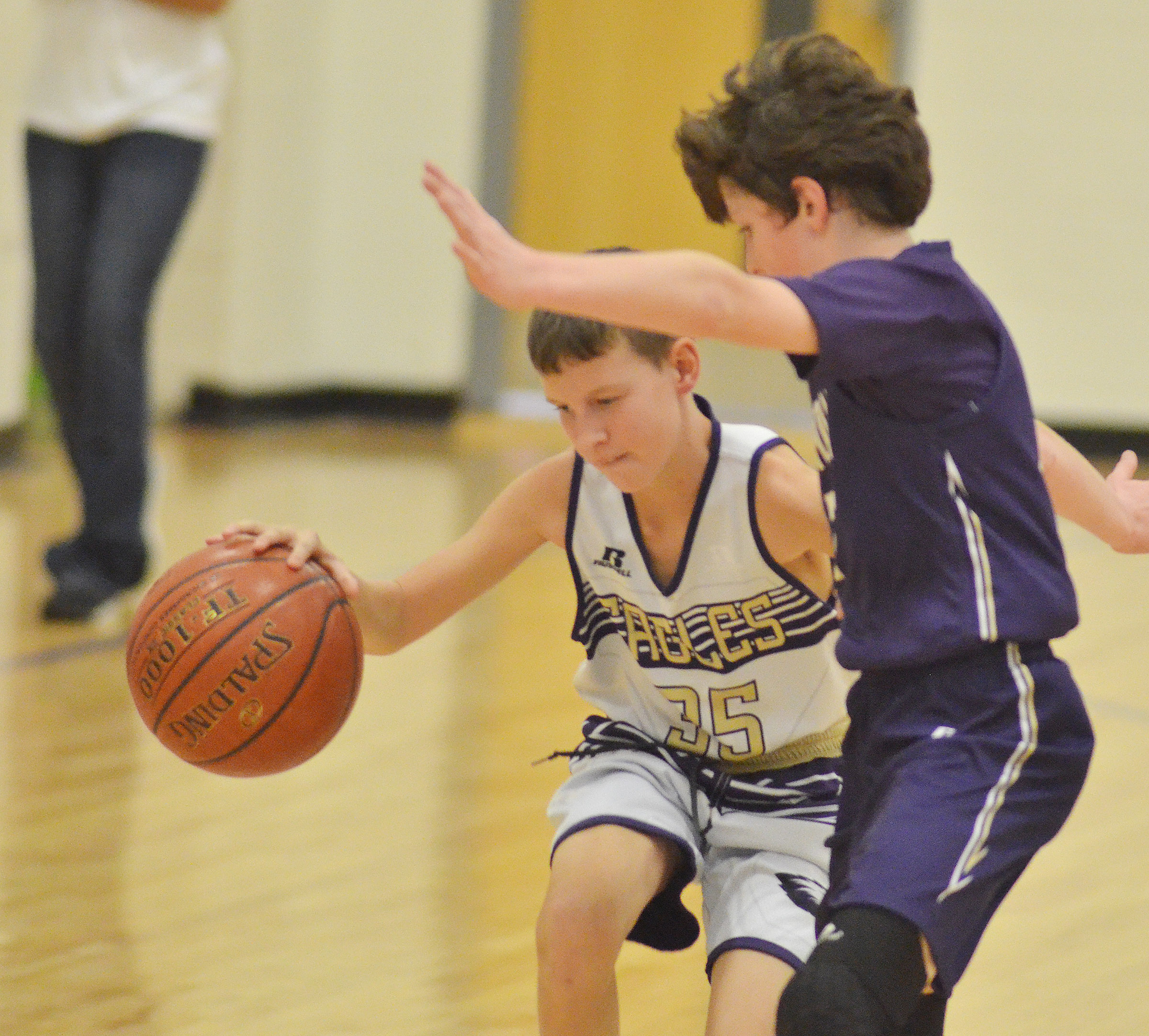 Campbellsville Elementary School fifth-grader Rowan Petett protects the ball.