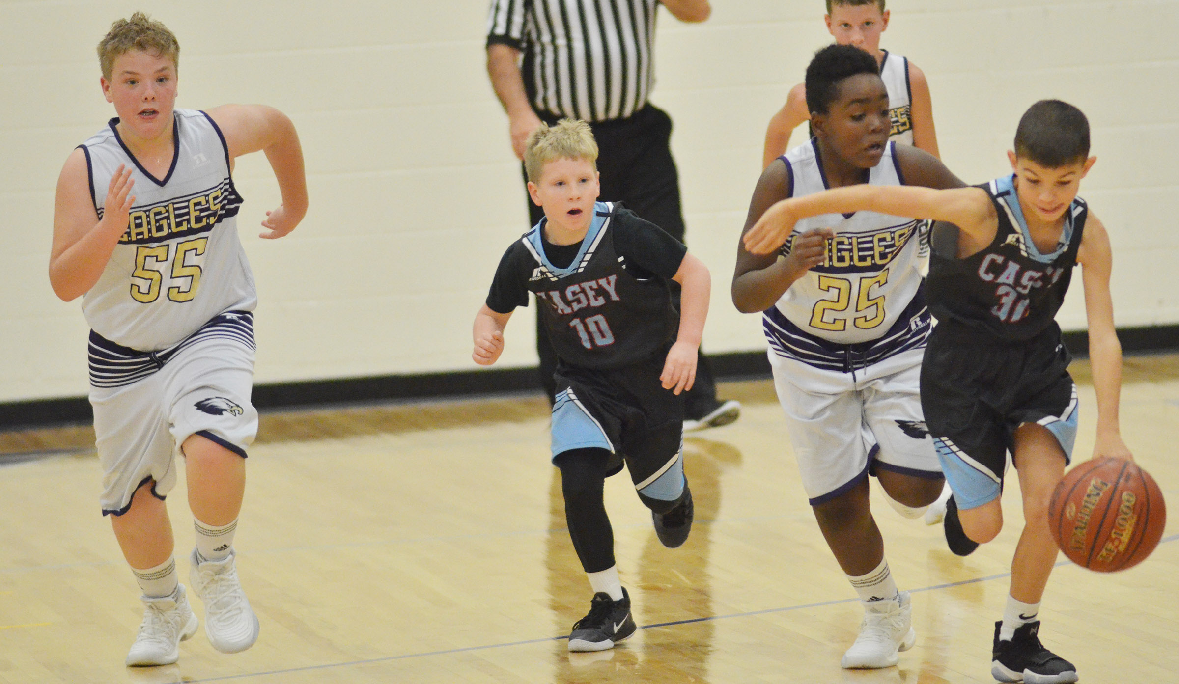 CMS sixth-grader Ryan Grubbs, at left, and Campbellsville Elementary School fifth-grader KeKe Miller play defense.