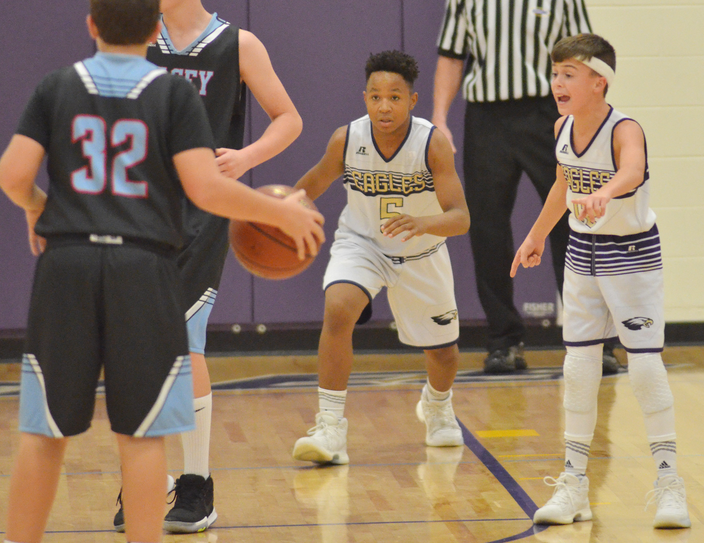 CMS seventh-graders Deondre Weathers, at left, and Chase Hord play defense.