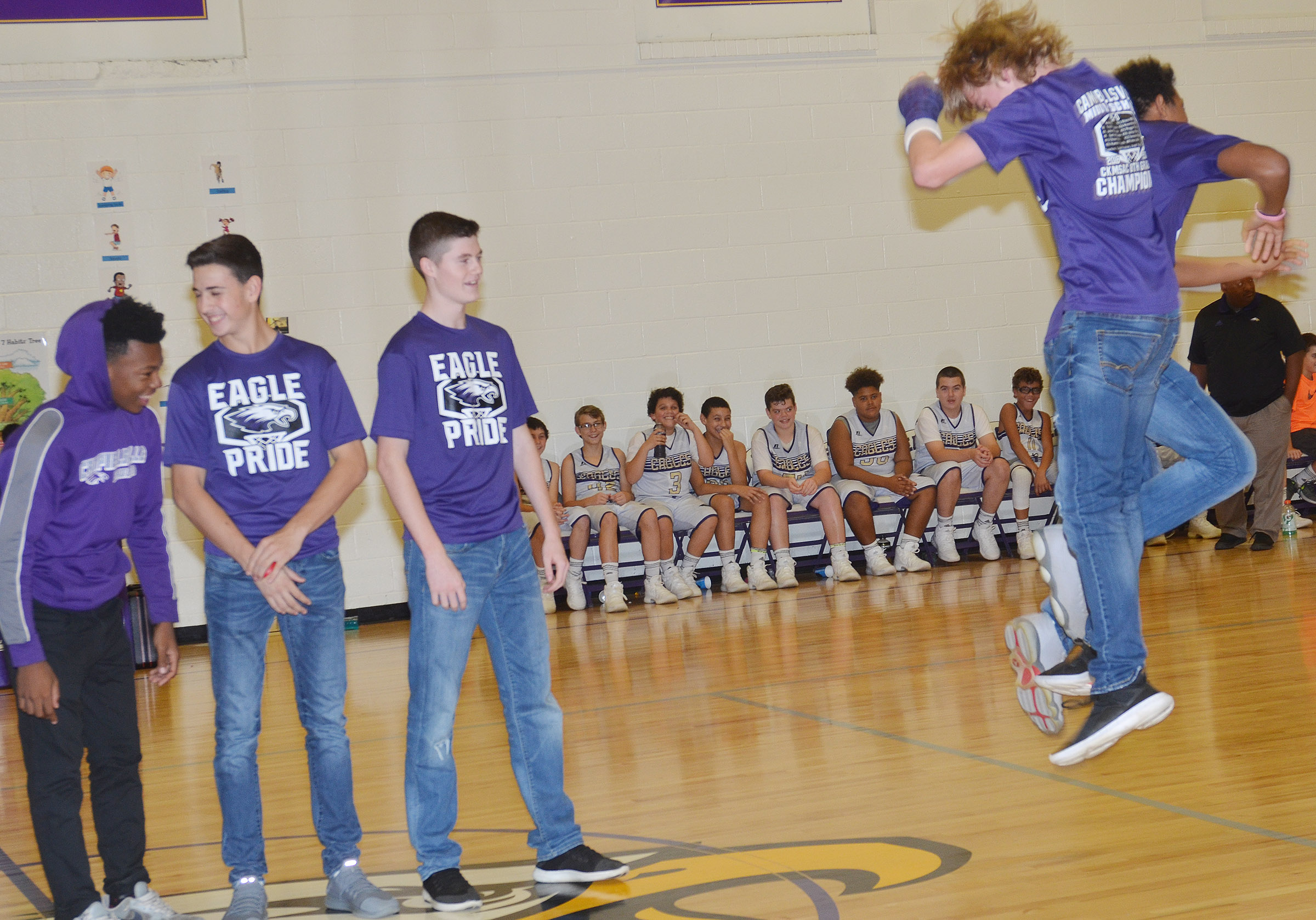 CHS freshmen Arren Hash and Jastyn Shively celebrate as they are honored for being a part of the CMS undefeated 2016-2017 boys' basketball team that won the CKMSAC regular season and tournament championships.